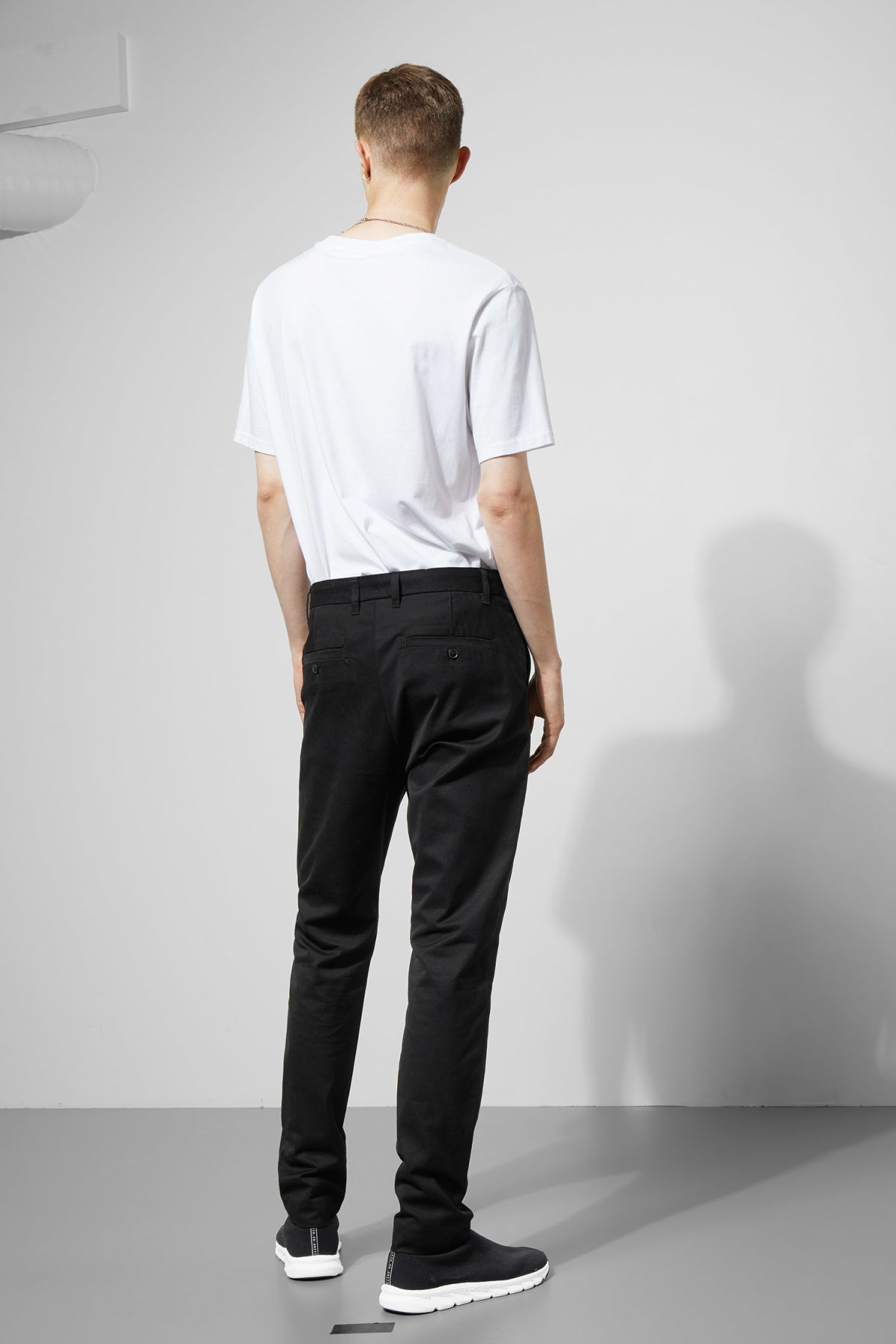 Model back image of Weekday forest chinos in black