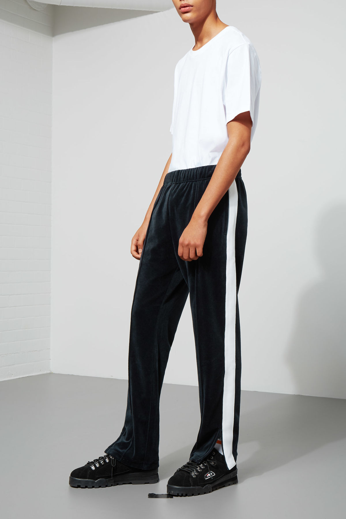 Model side image of Weekday local velour sweatpants in blue