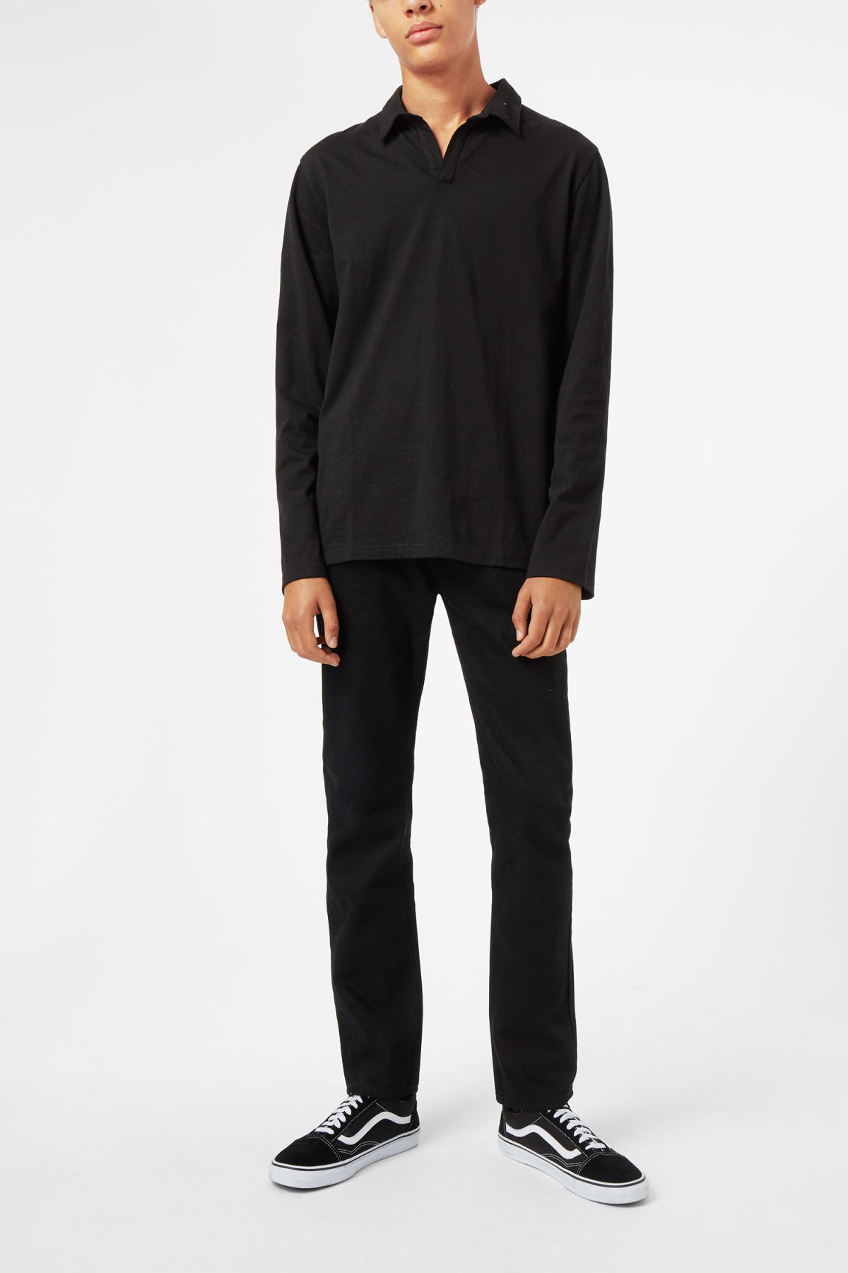 Model side image of Weekday pop polo long sleeve in black