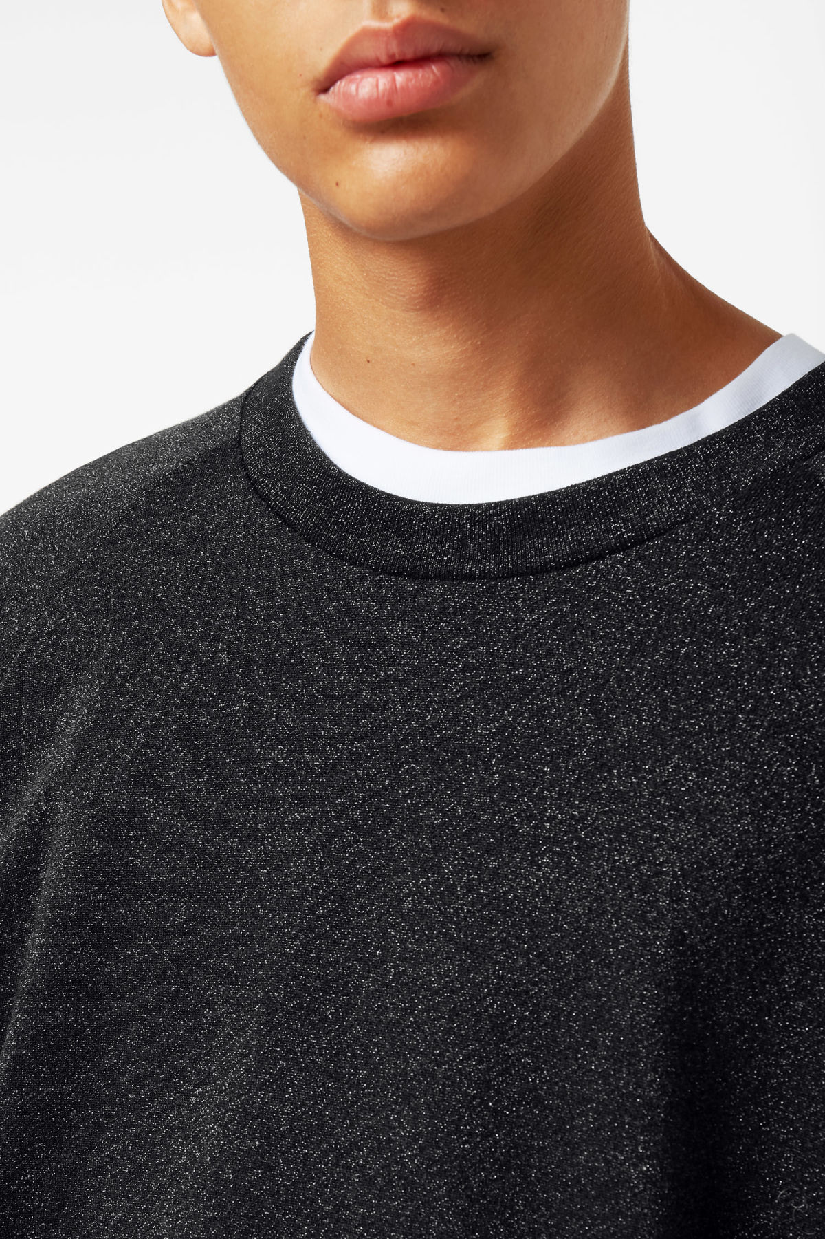 Model side image of Weekday curt glitter sweatshirt in black