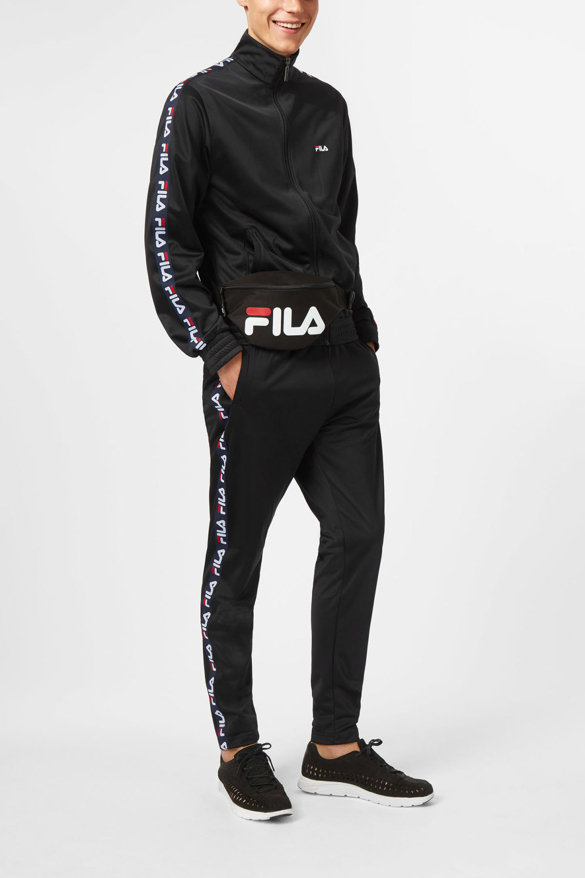 Model side image of Weekday strap track jacket in black