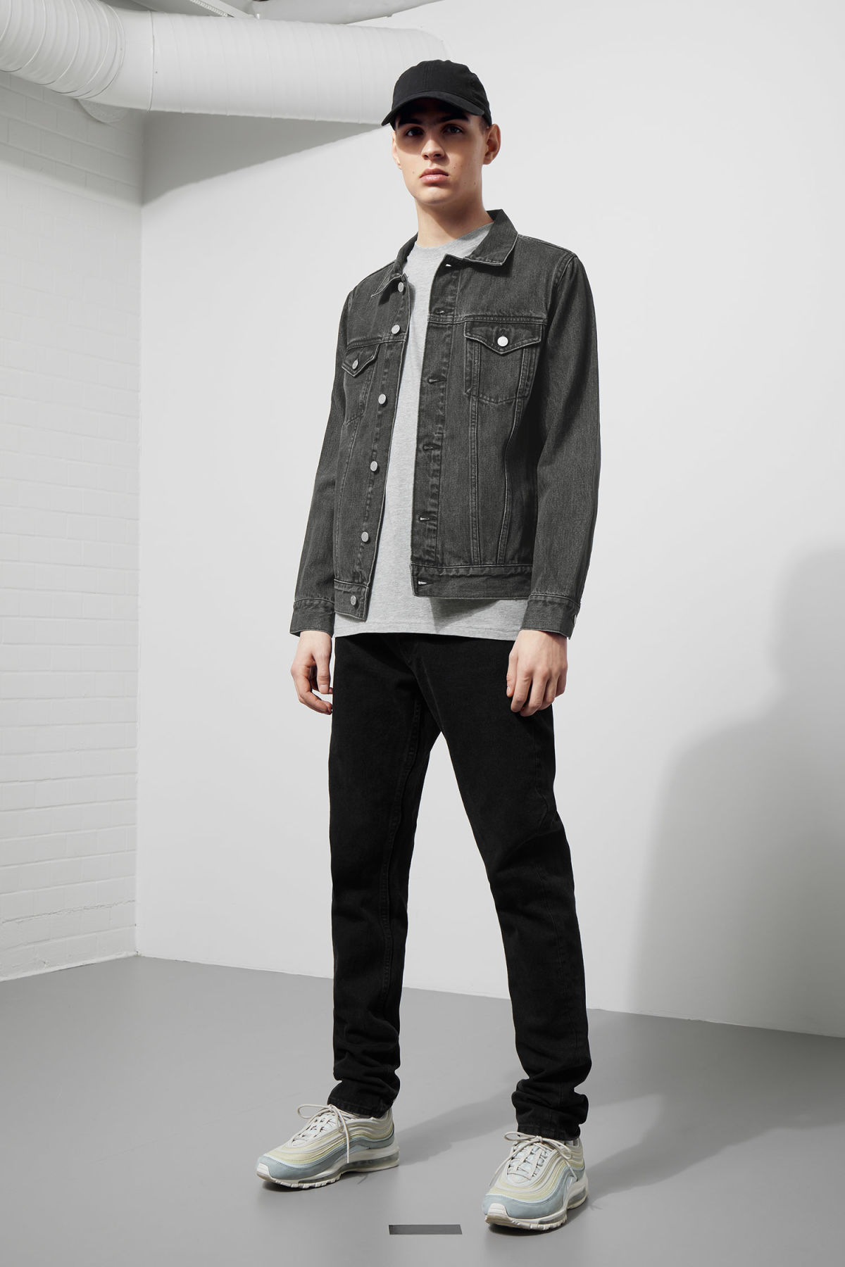 Model side image of Weekday single free black jacket  in grey