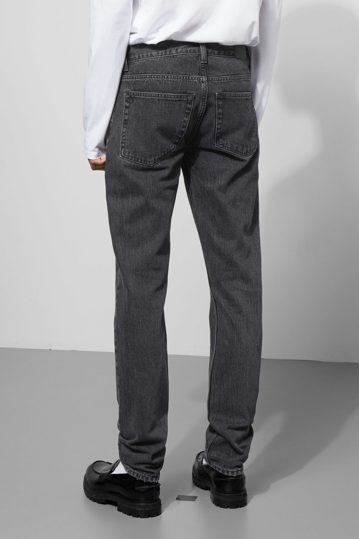 Model side image of Weekday friday trotter black jeans in grey