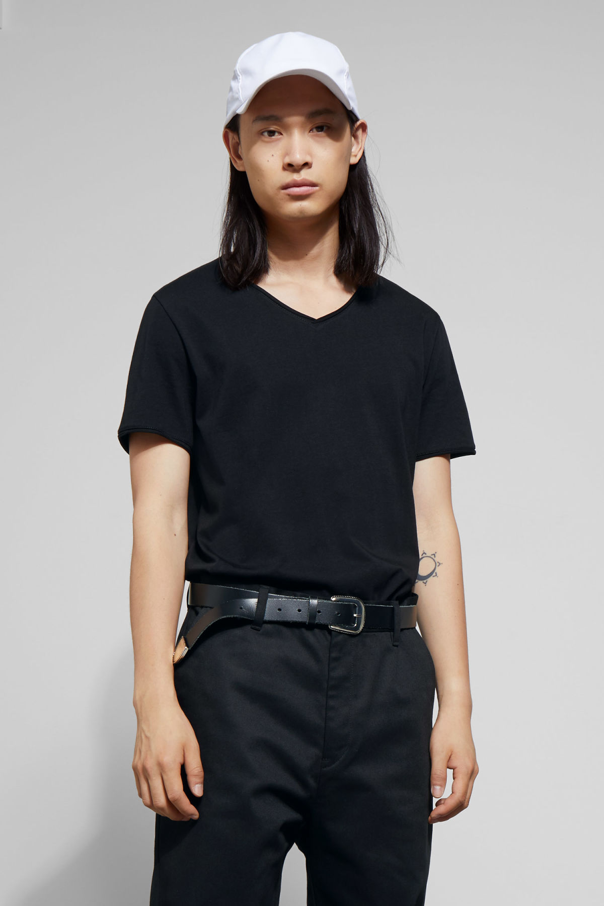 Model front image of Weekday dark v-neck t-shirt in black