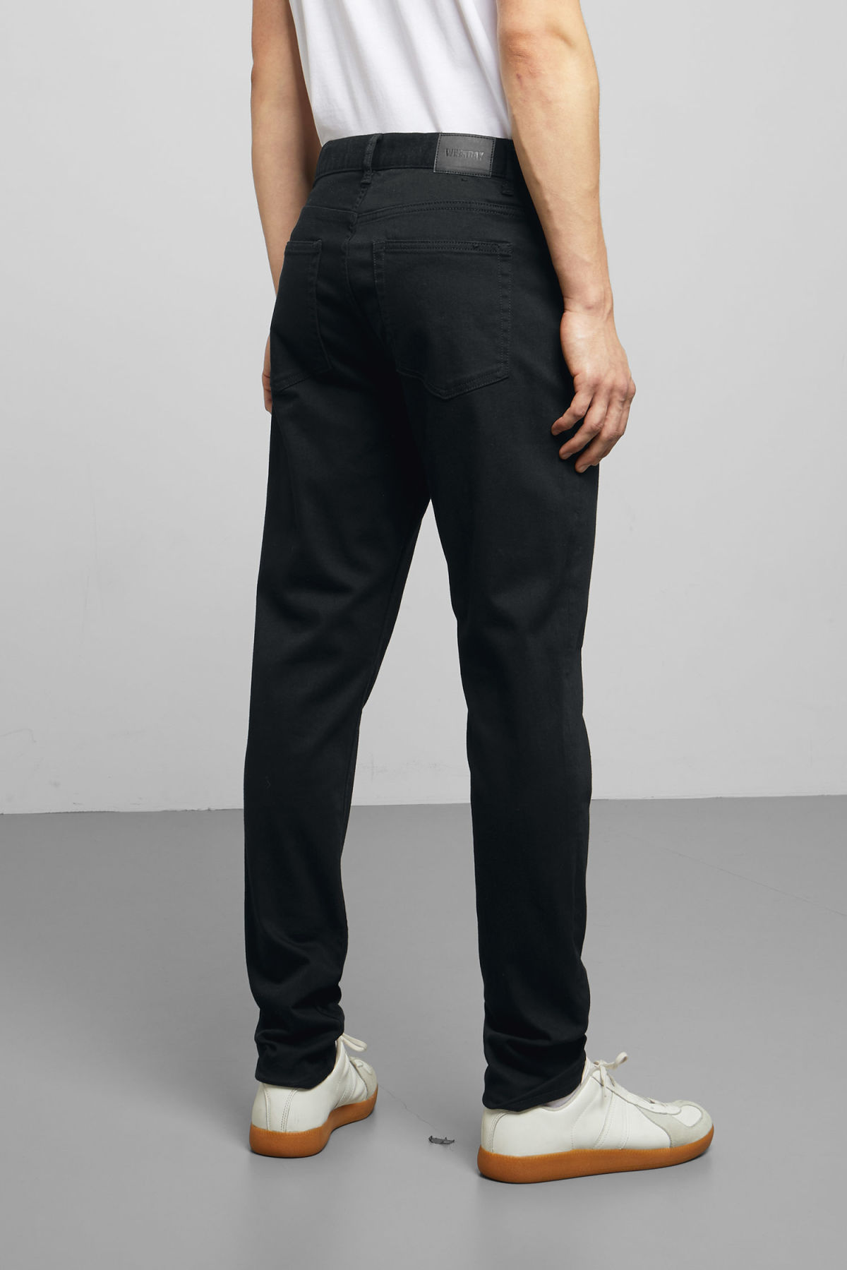 Model side image of Weekday cone stay black jeans in black