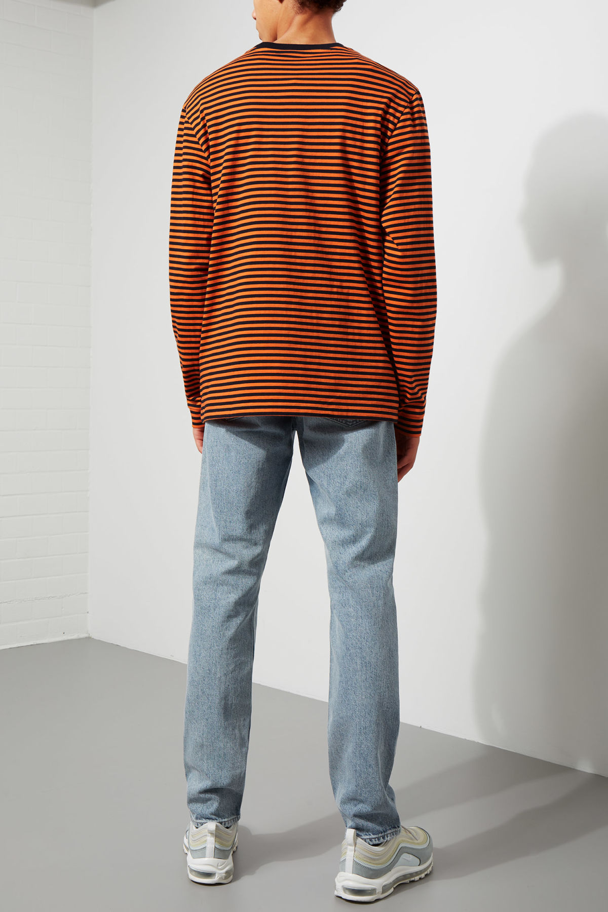 Model side image of Weekday leonardo stripe long sleeve in orange