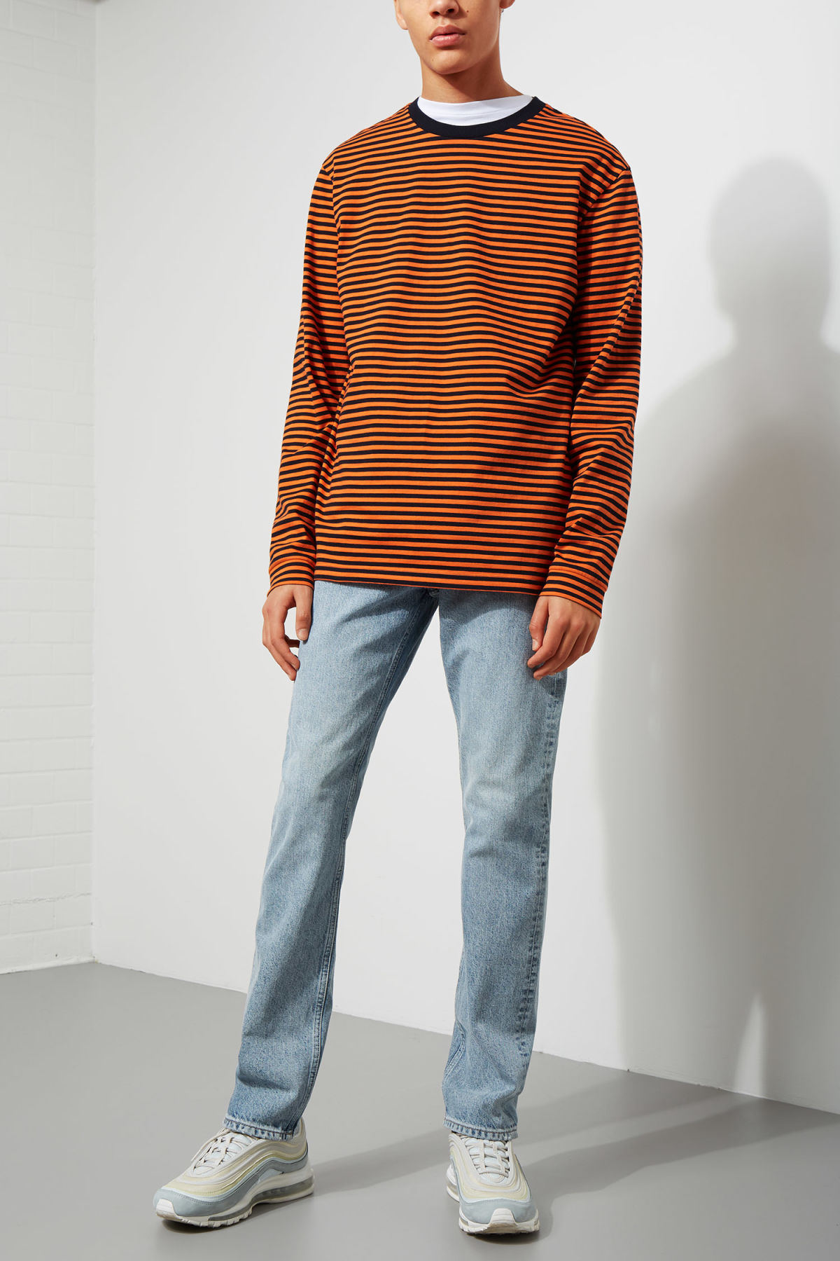 Model back image of Weekday leonardo stripe long sleeve in orange