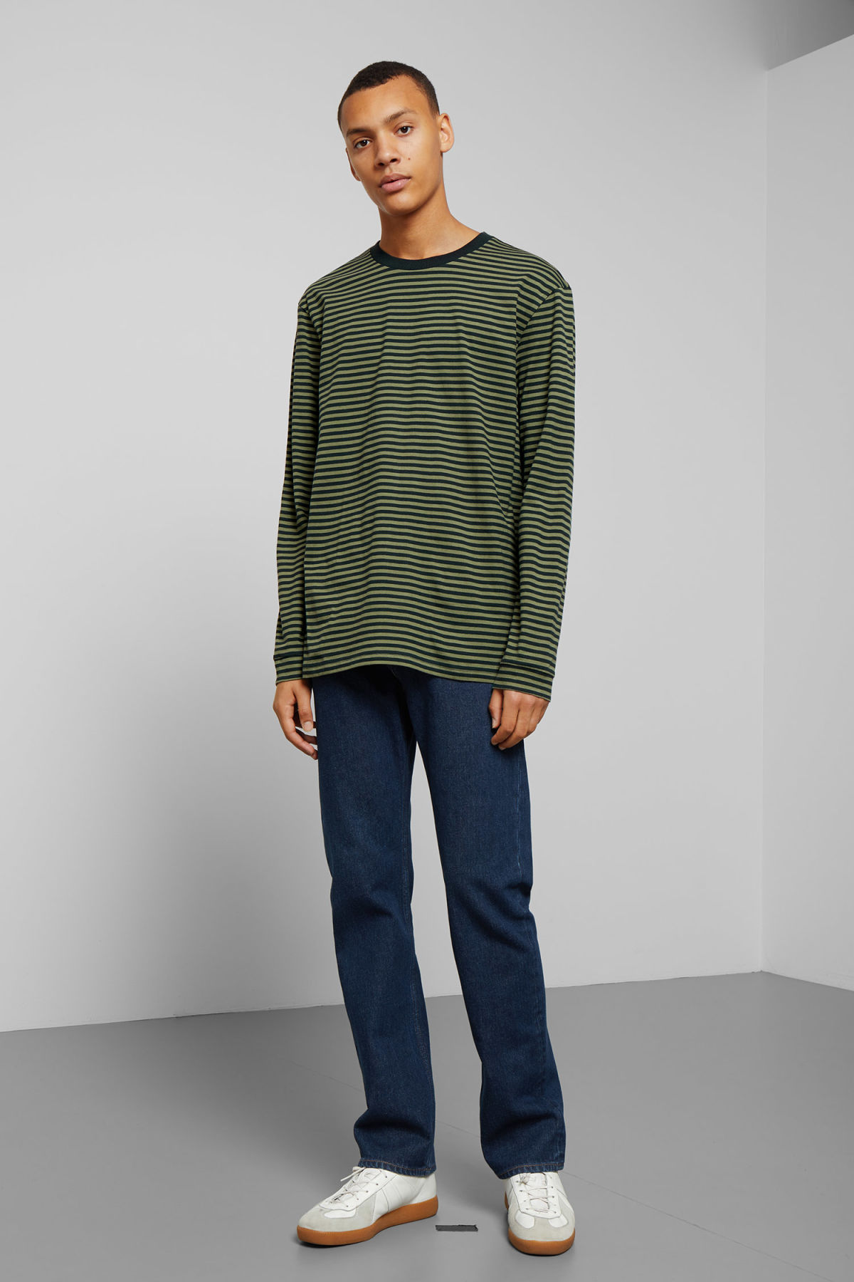 Model side image of Weekday leonardo stripe long sleeve in green