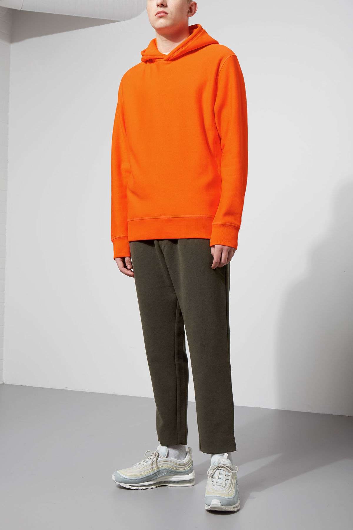 Model side image of Weekday sol hoodie in orange