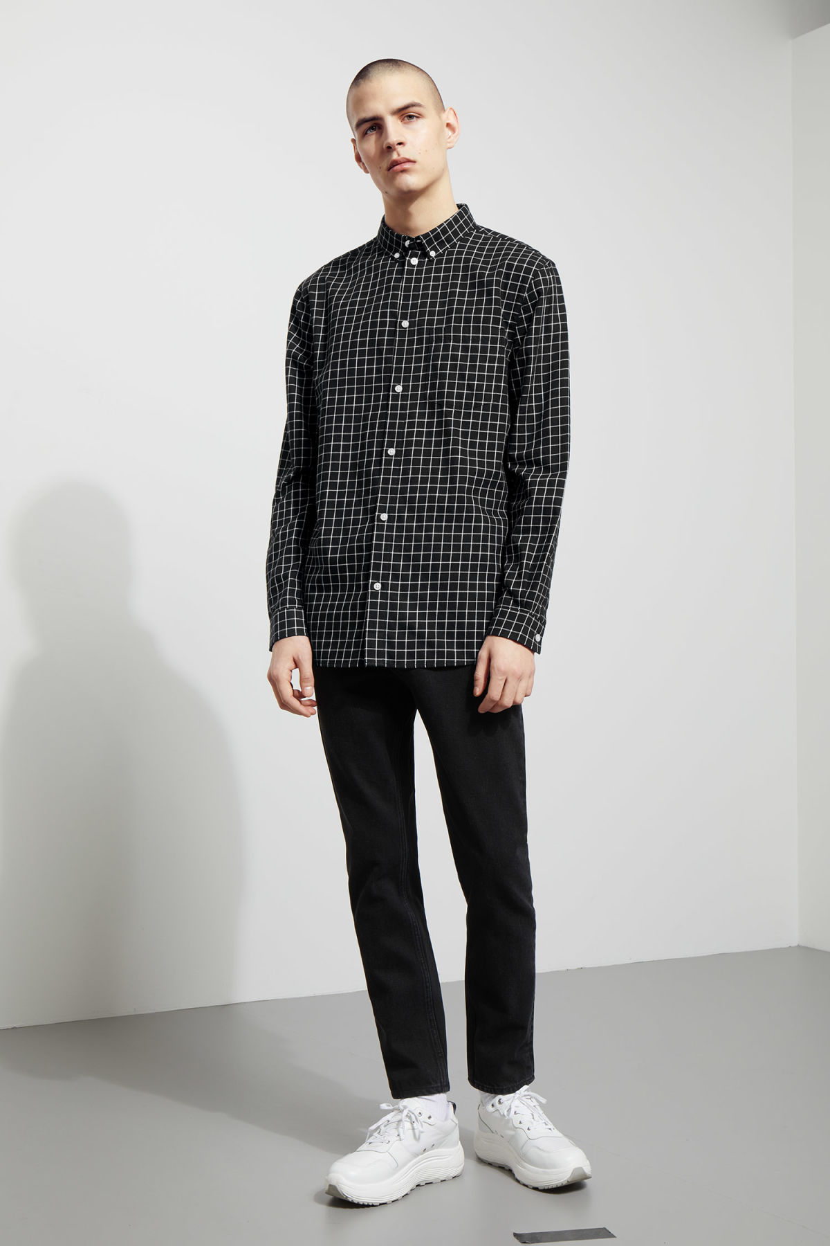 Model side image of Weekday ray windowpane shirt in black