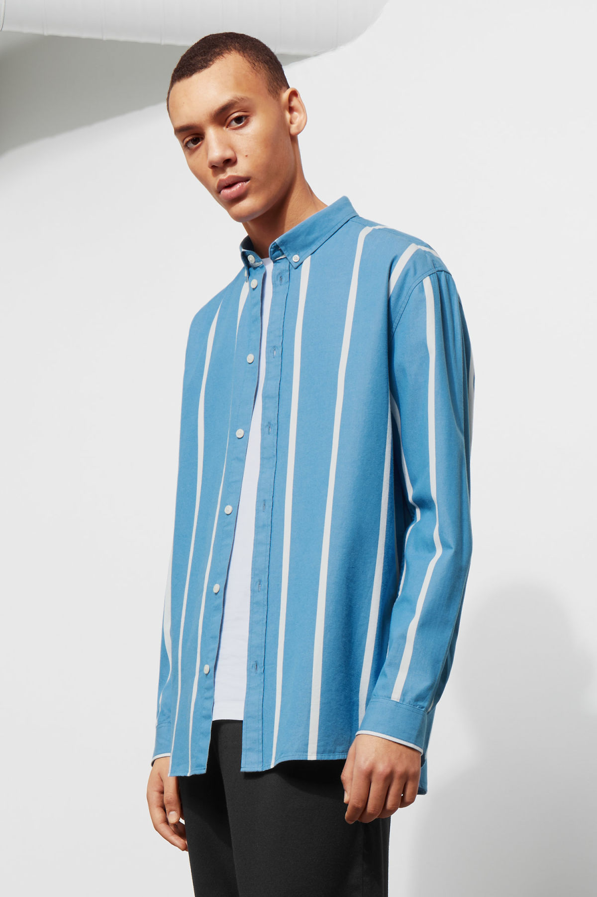 Model front image of Weekday balance striped shirt in blue
