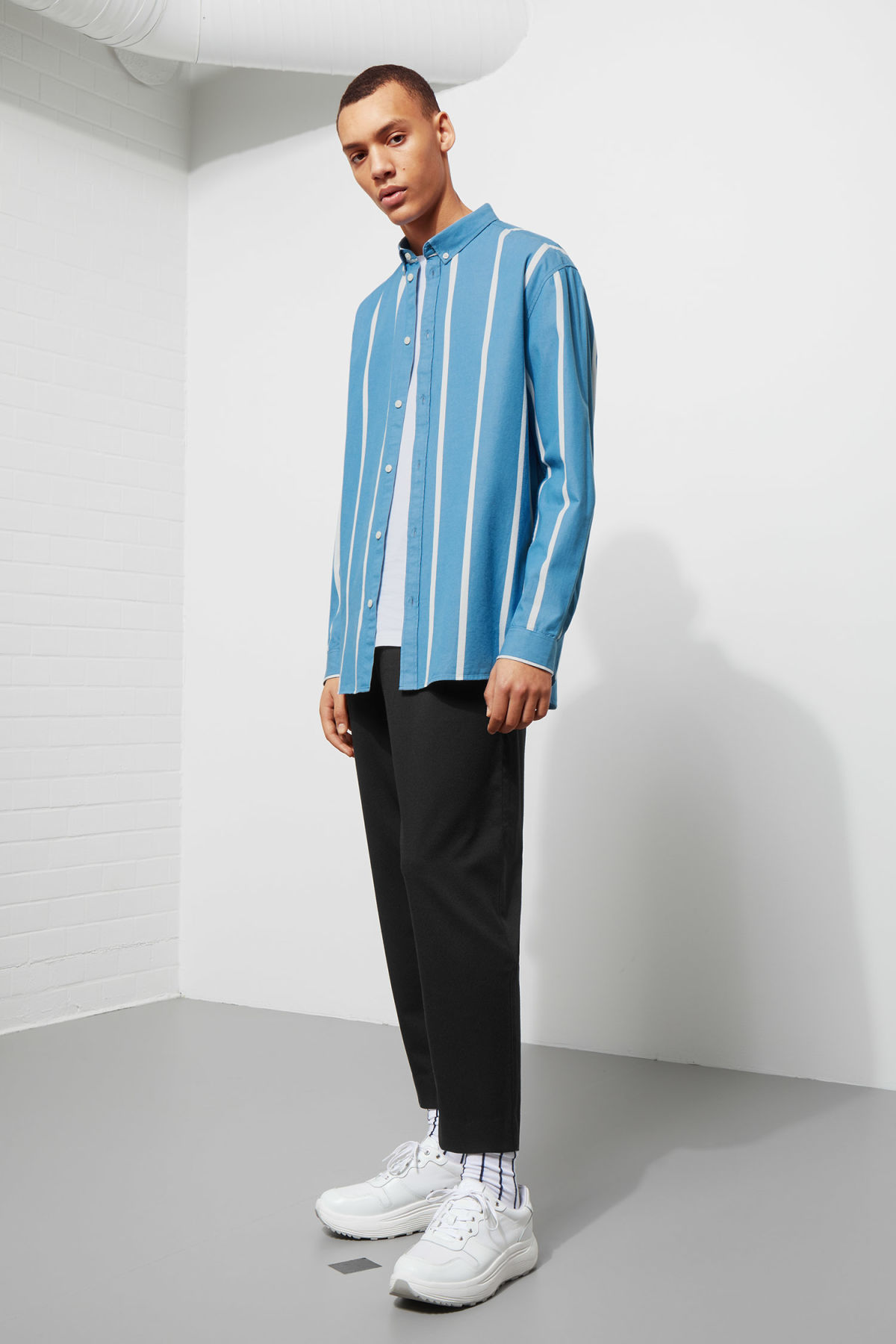Model side image of Weekday balance striped shirt in blue