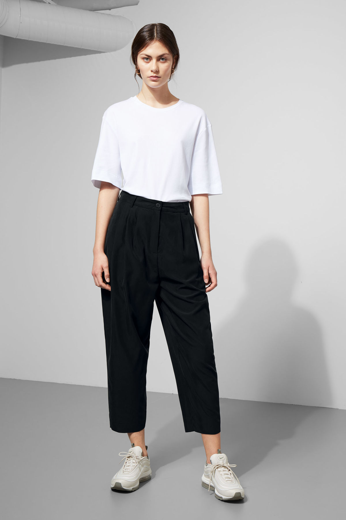Model front image of Weekday milly pleat trousers in black