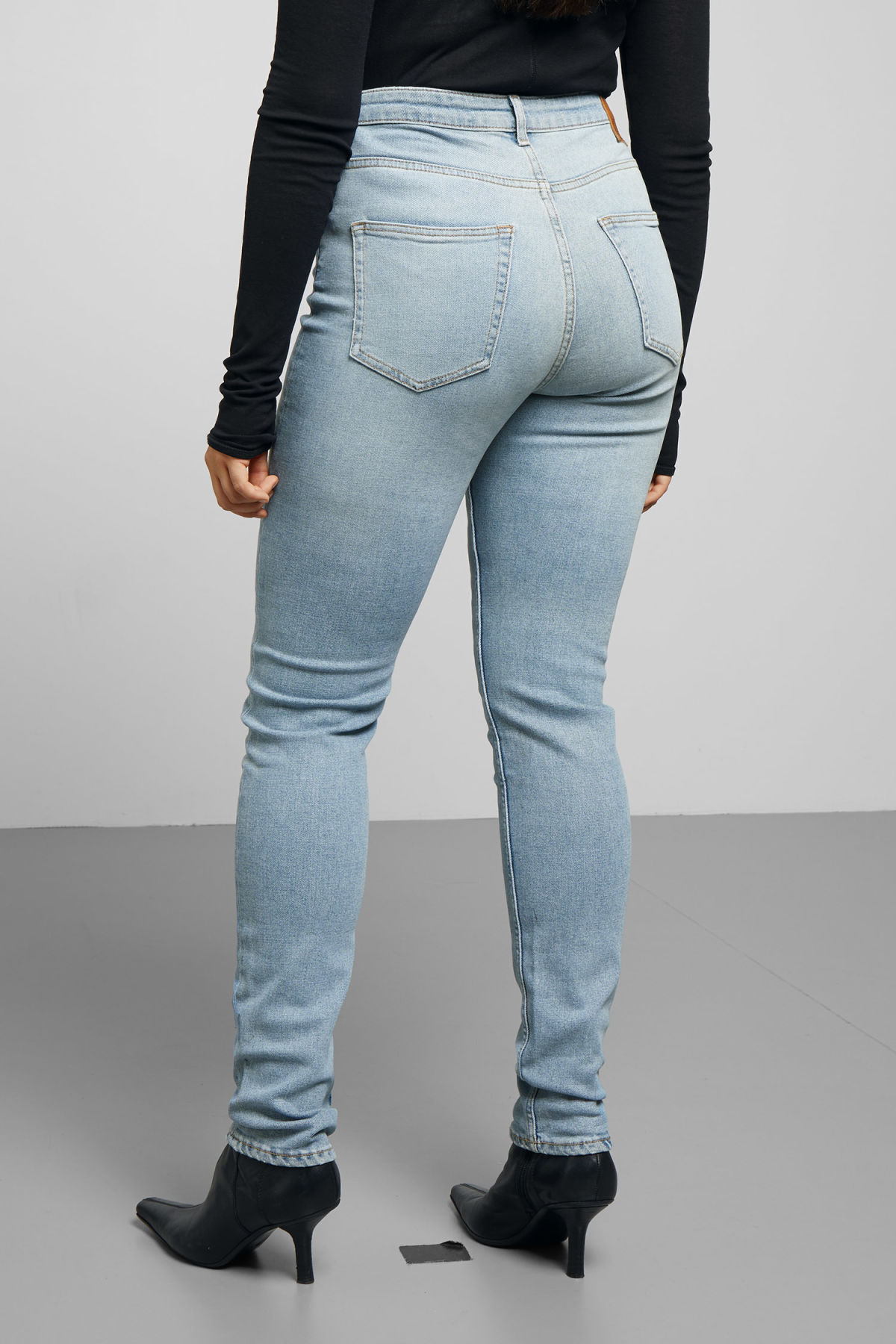 Model side image of Weekday thursday reused blue cut jeans in blue