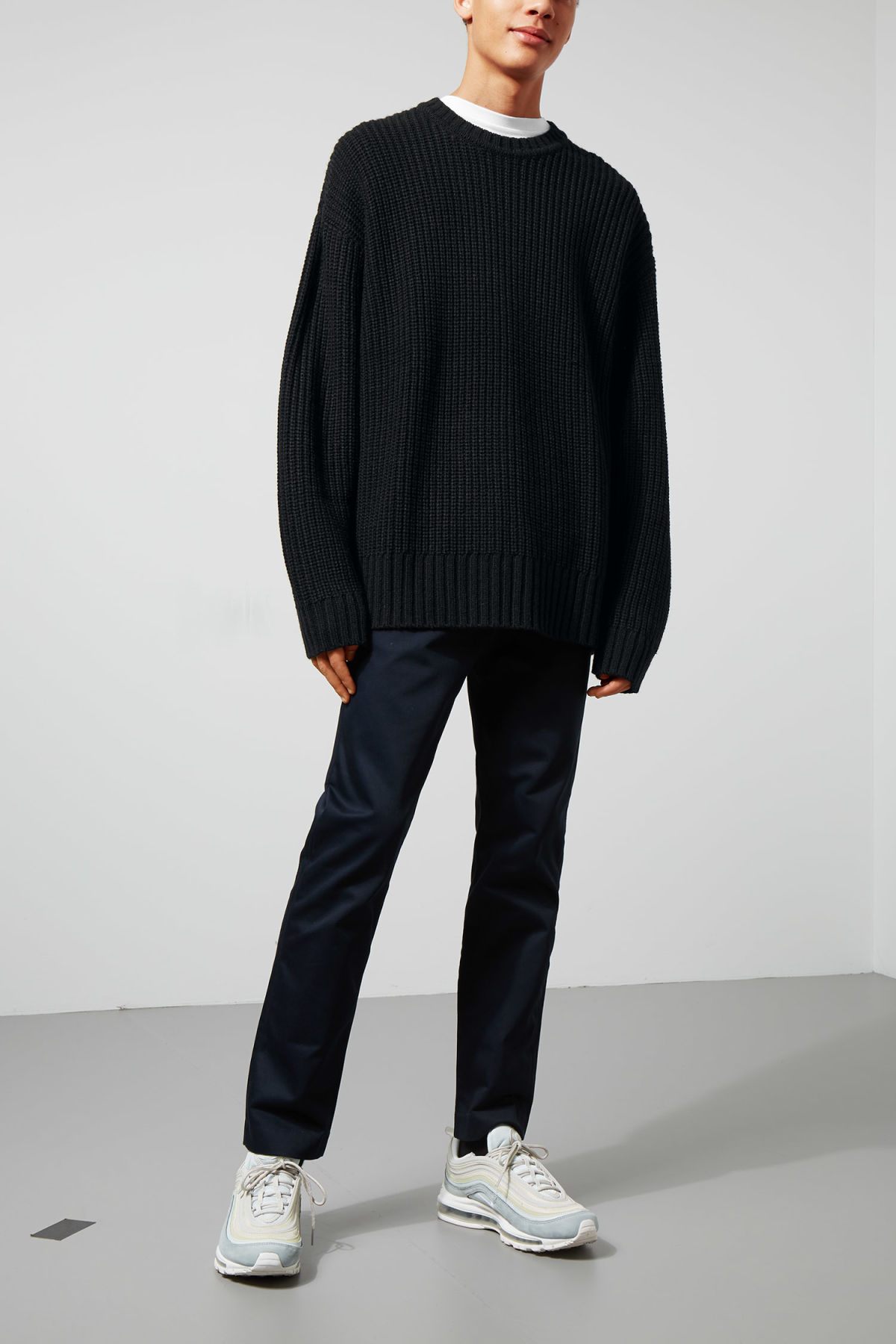 Model side image of Weekday dieago sweater in black