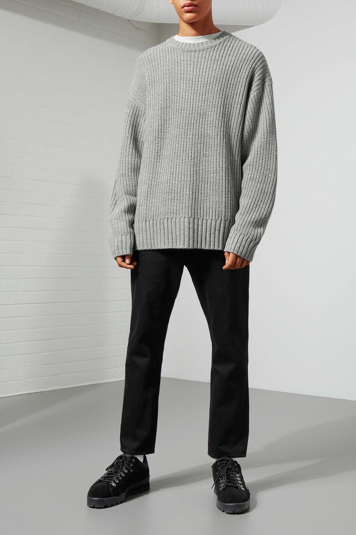 Model side image of Weekday dieago sweater in grey