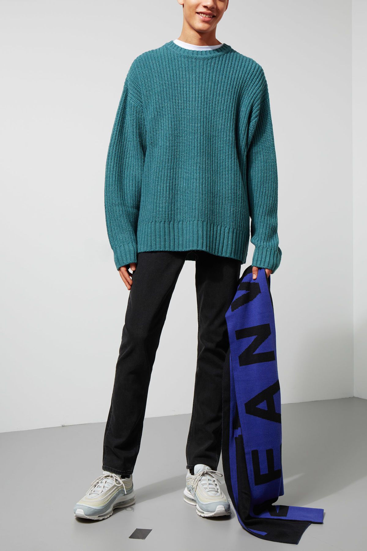 Model side image of Weekday dieago sweater in turquoise