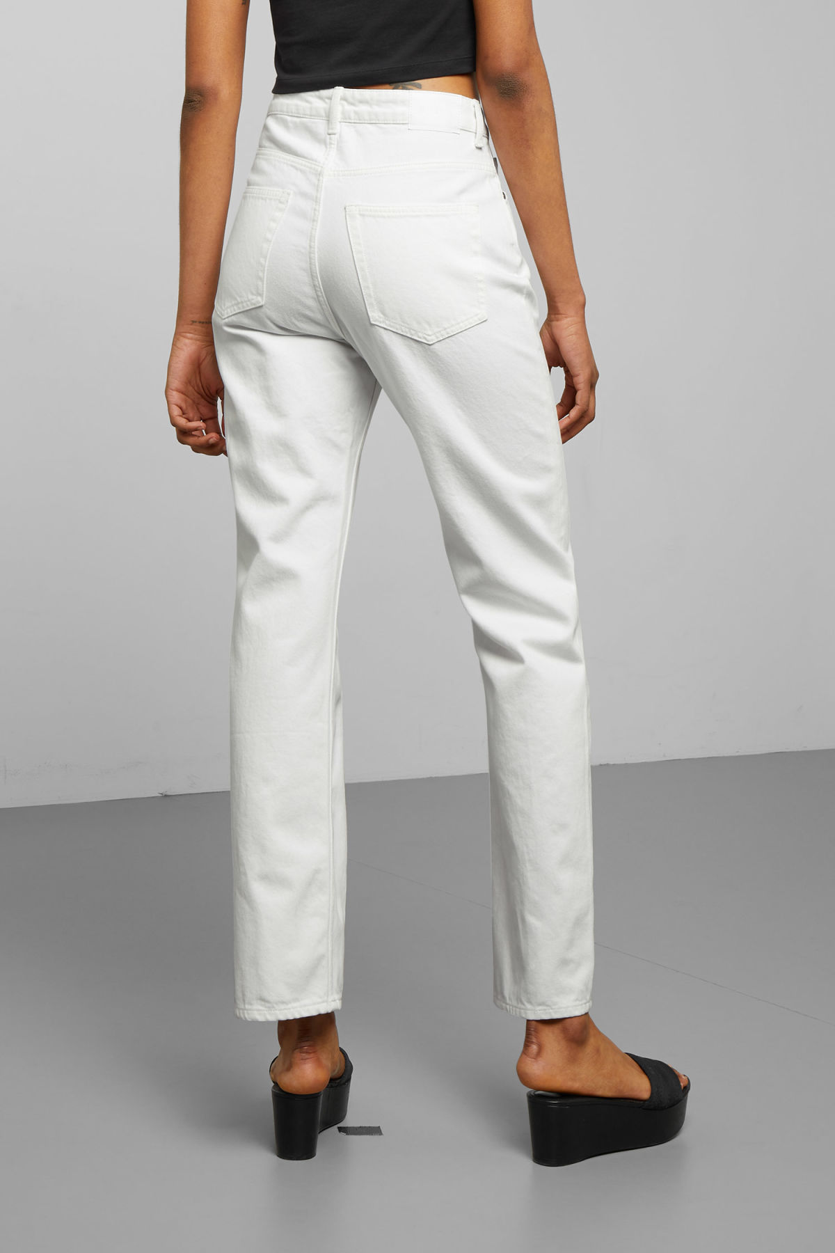 Model side image of Weekday voyage loved white jeans in white