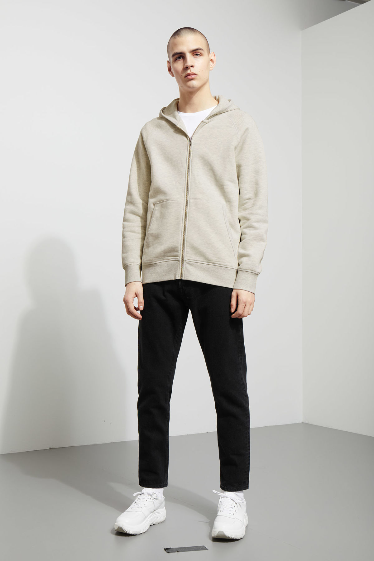 Model side image of Weekday stark hoodie in beige
