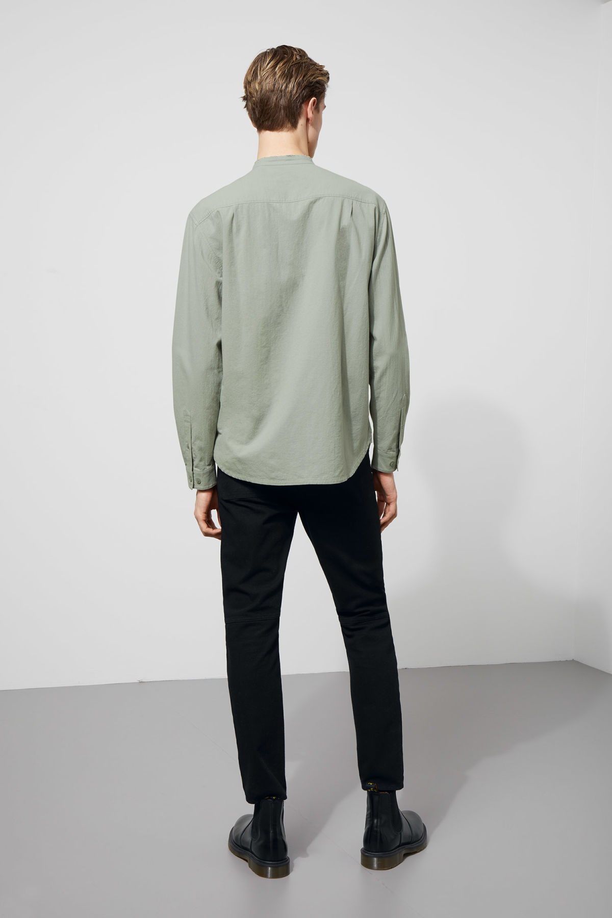 Model side image of Weekday rose shirt in green