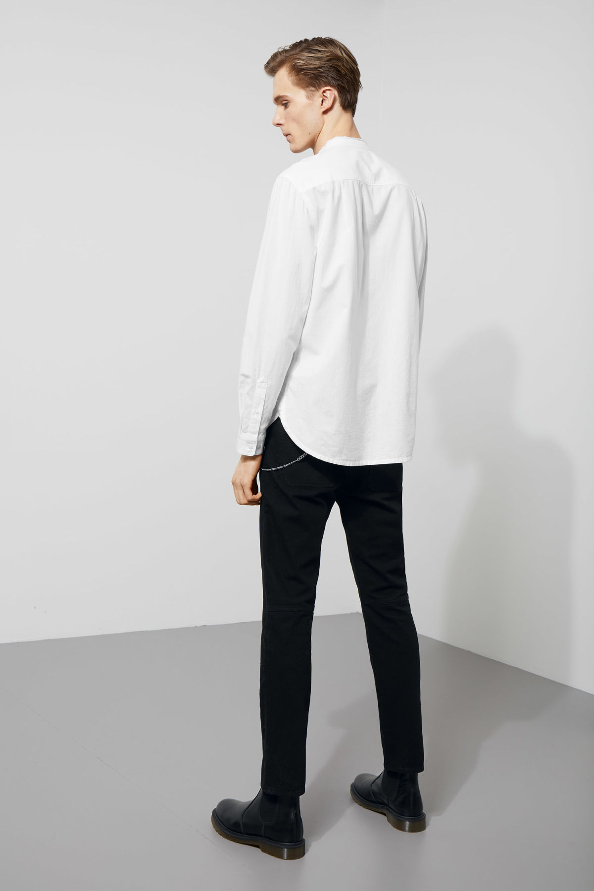 Model side image of Weekday rose shirt in white