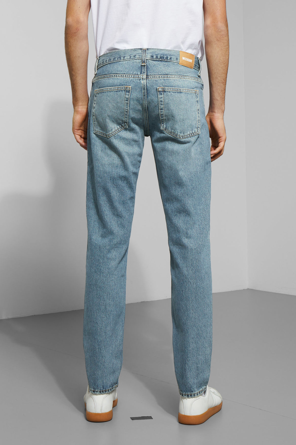 Model side image of Weekday friday mint blue jeans in blue