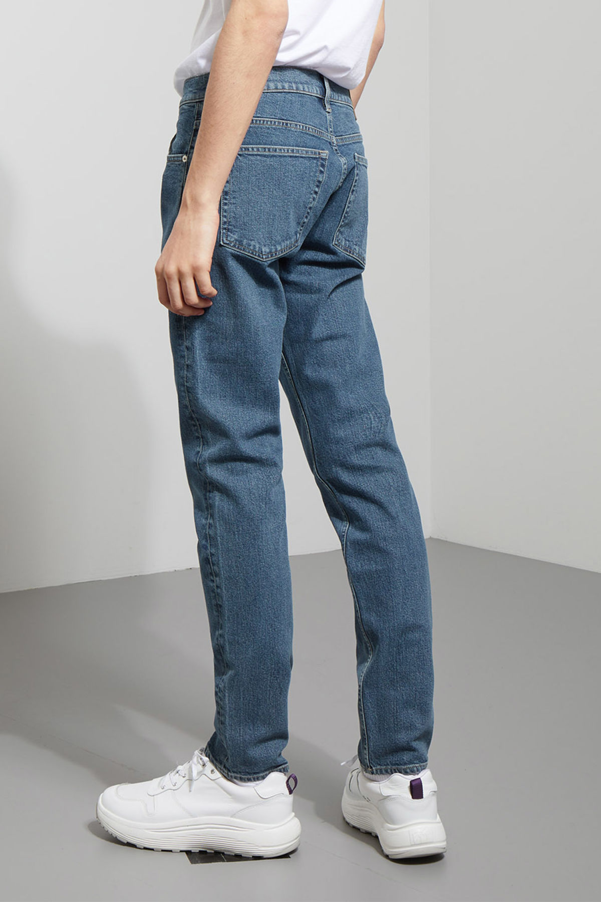 Model side image of Weekday friday dry blue jeans in blue
