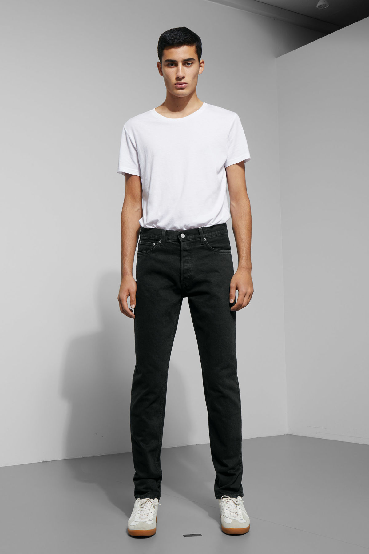 Model front image of Weekday pine tuned black jeans in black