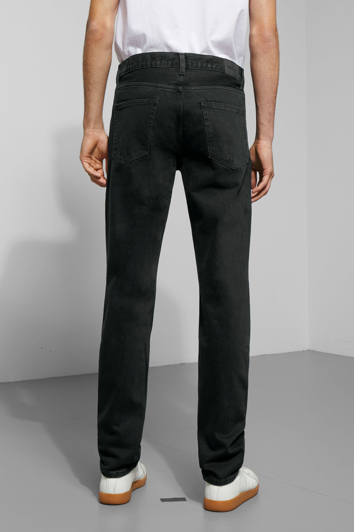 Model side image of Weekday pine tuned black jeans in black