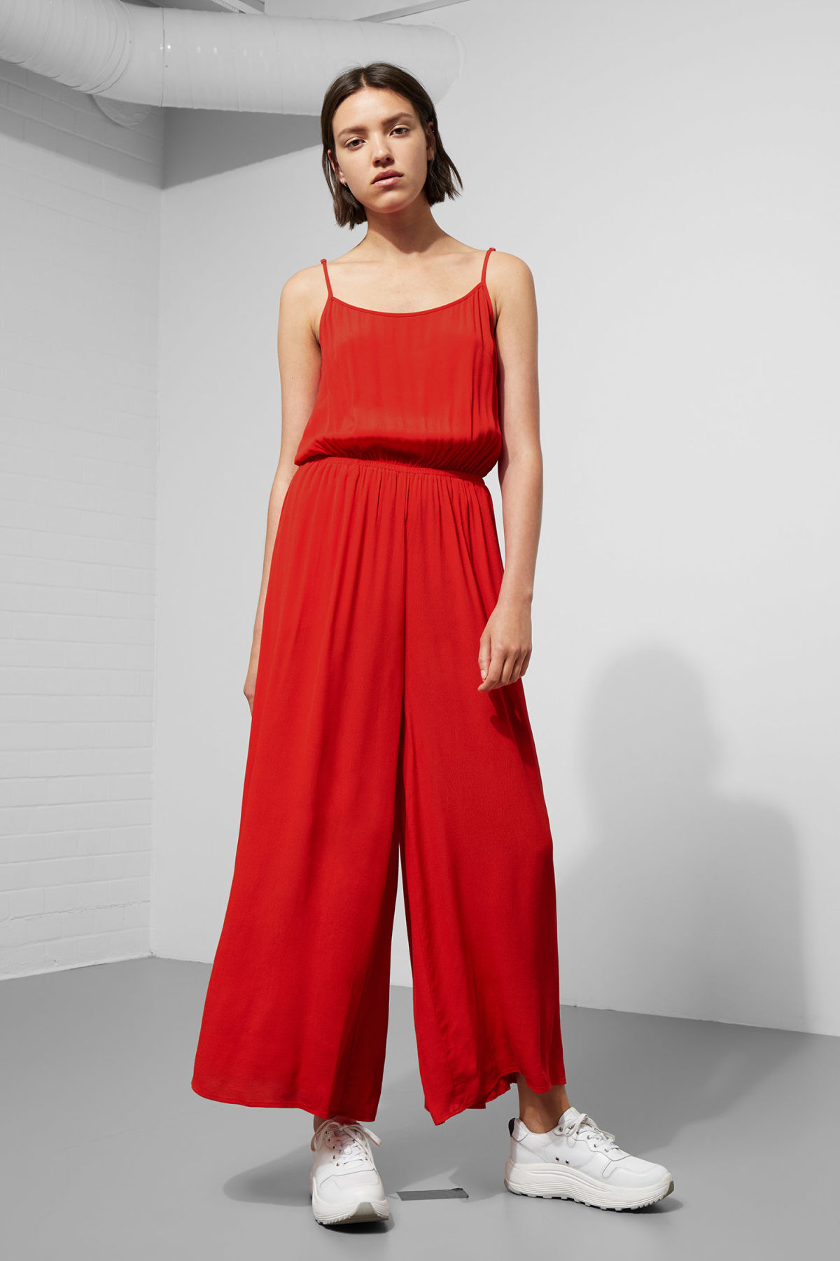 Model front image of Weekday elora jumpsuit in red