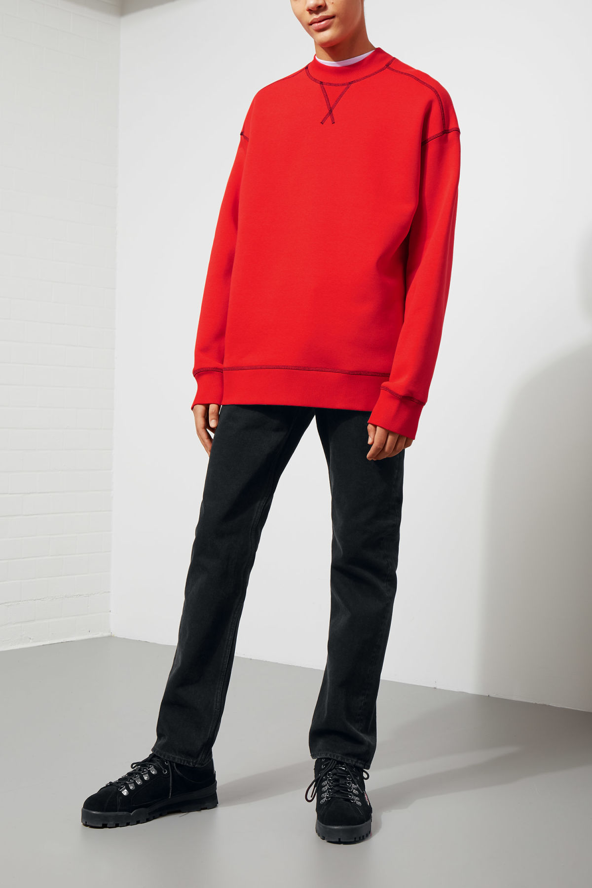 Model side image of Weekday syntax sweatshirt in red