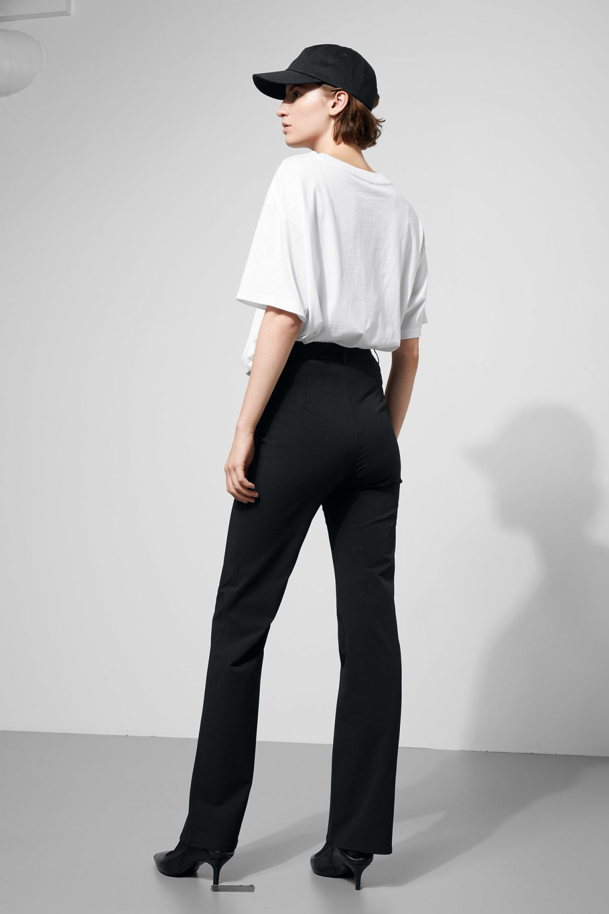 Model side image of Weekday manet trousers in black