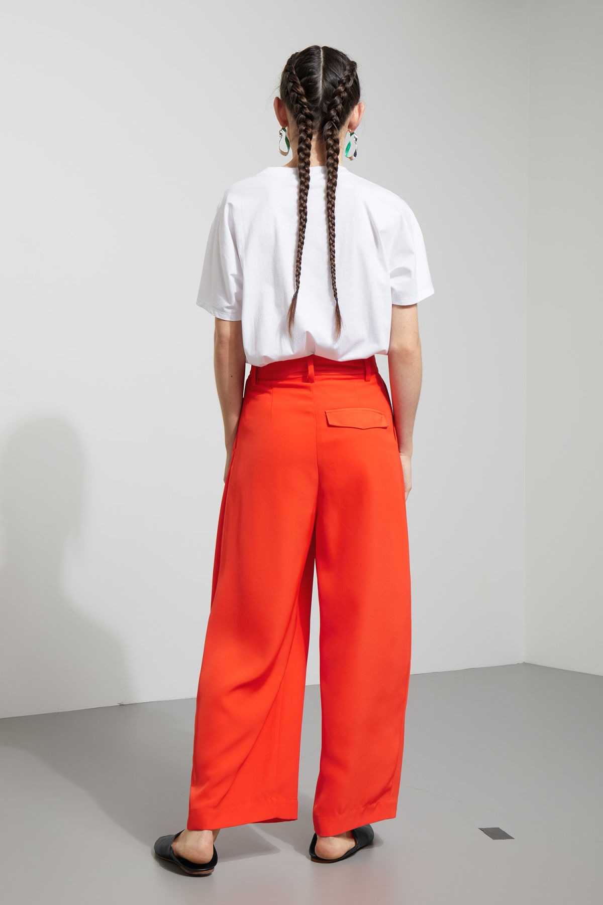 Model side image of Weekday mount trousers in orange