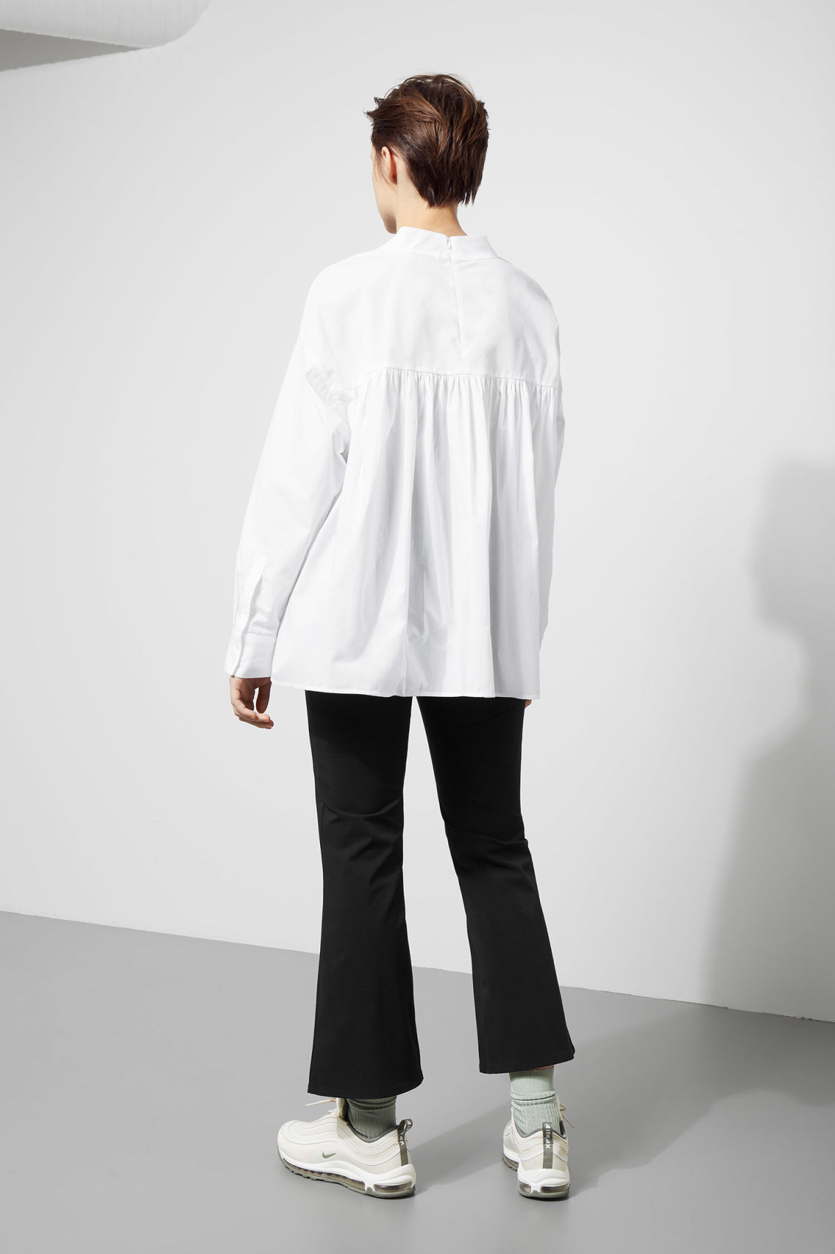 Model side image of Weekday pablo blouse in white