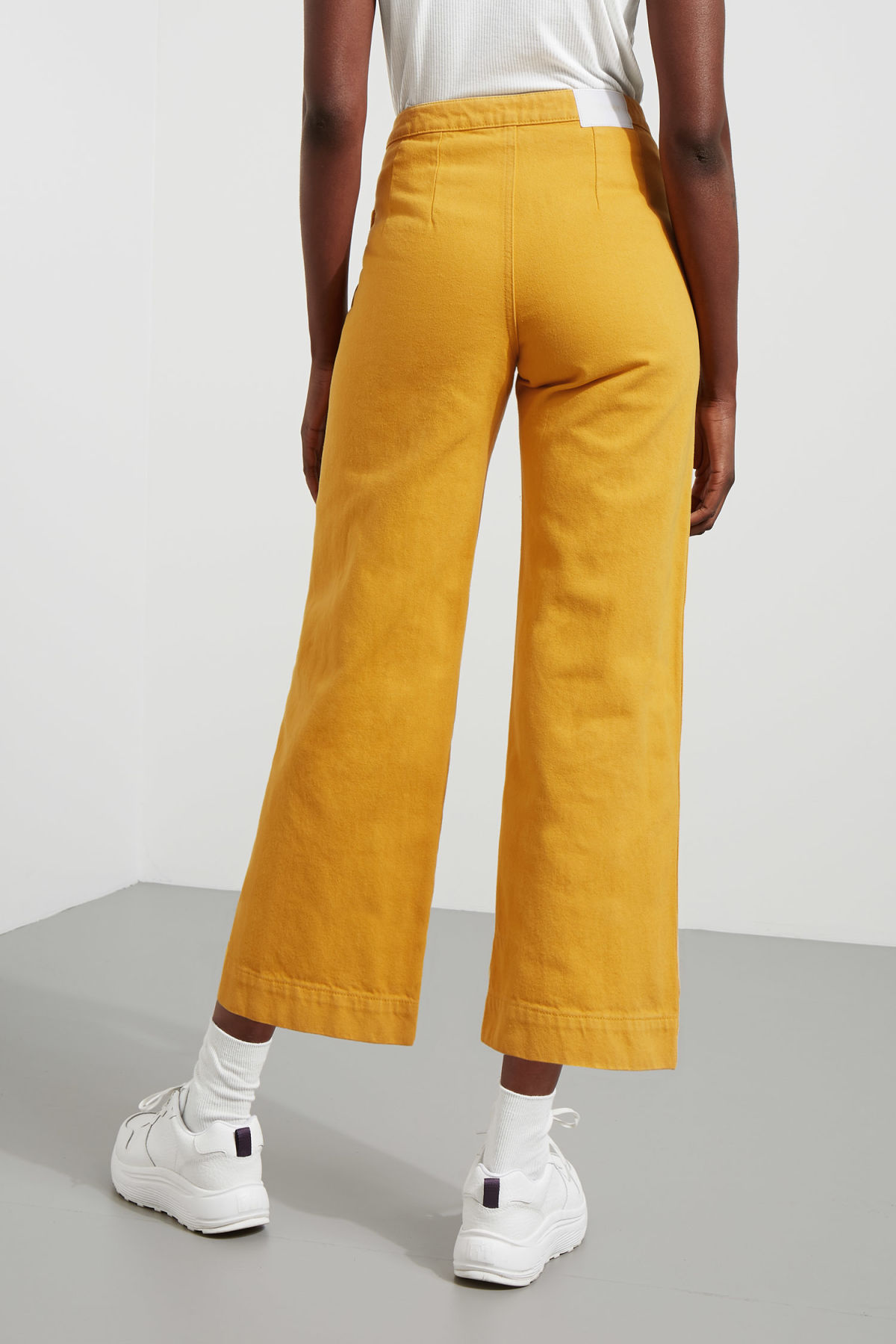 Model back image of Weekday vida yellow denim trousers in yellow