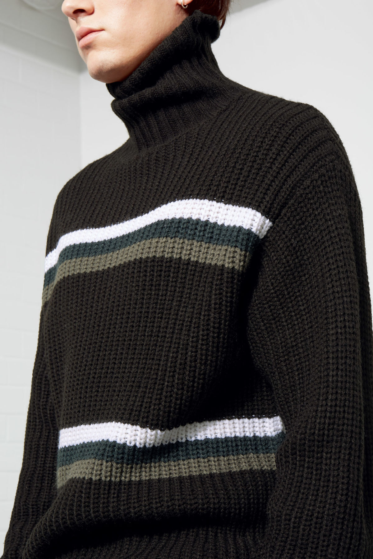 Model side image of Weekday loop turtleneck sweater in black