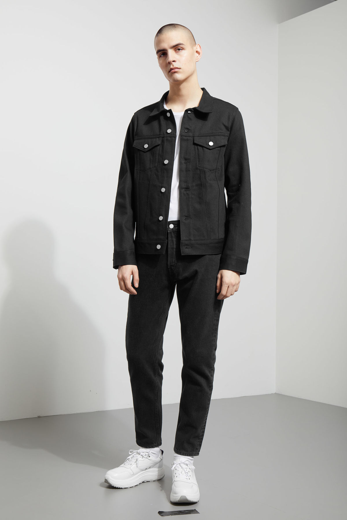 Model side image of Weekday single unwashed black jacket in black
