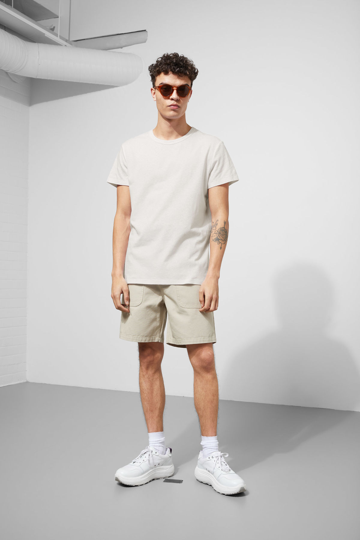 Model side image of Weekday linen t-shirt in white