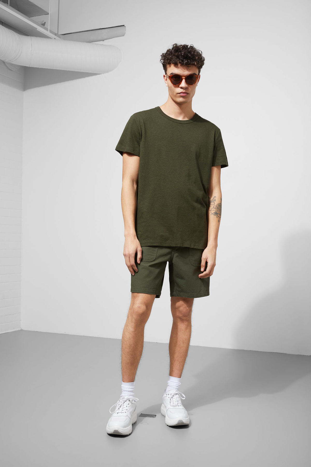 Model side image of Weekday linen t-shirt in green