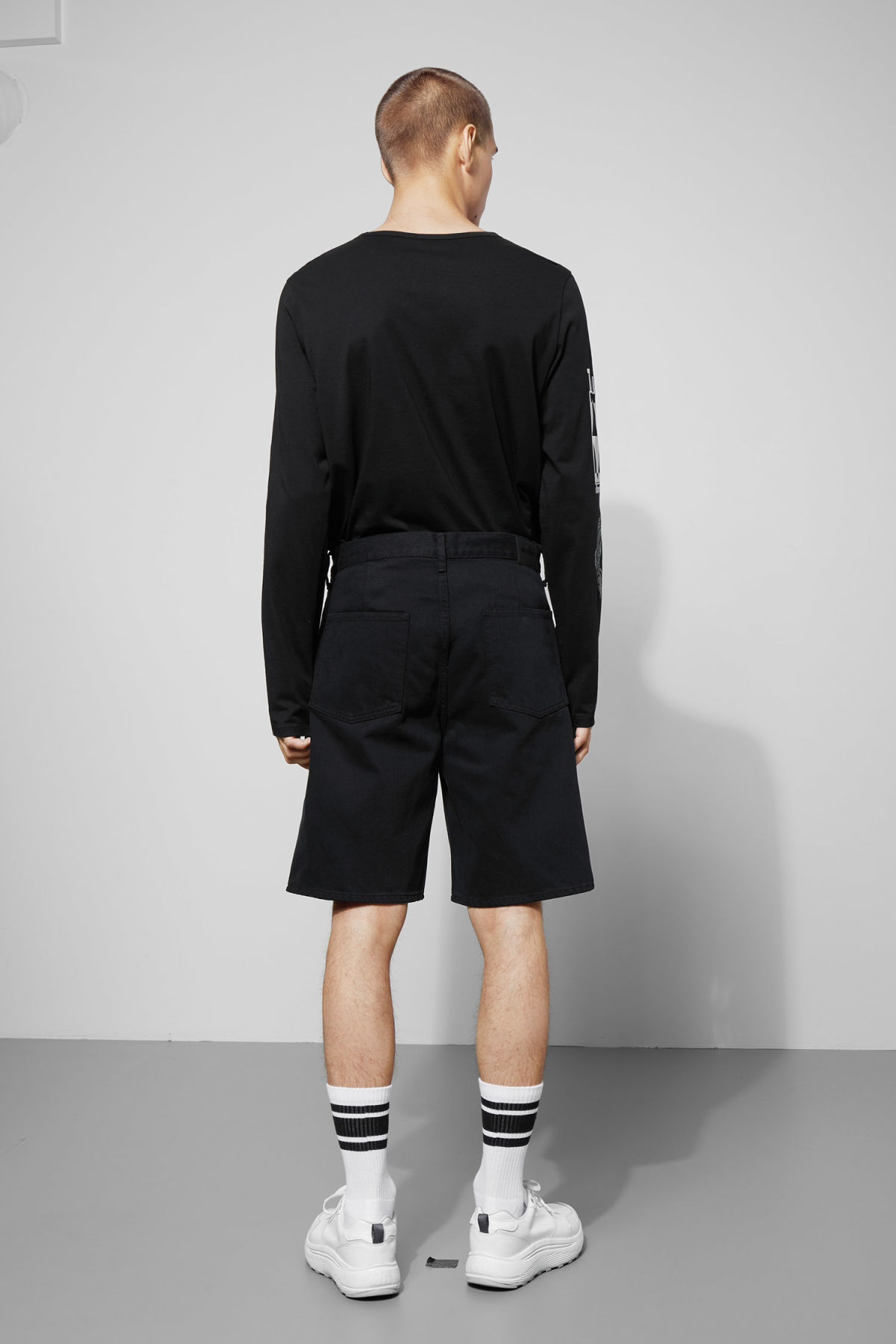 Model side image of Weekday relay od black denim shorts  in black