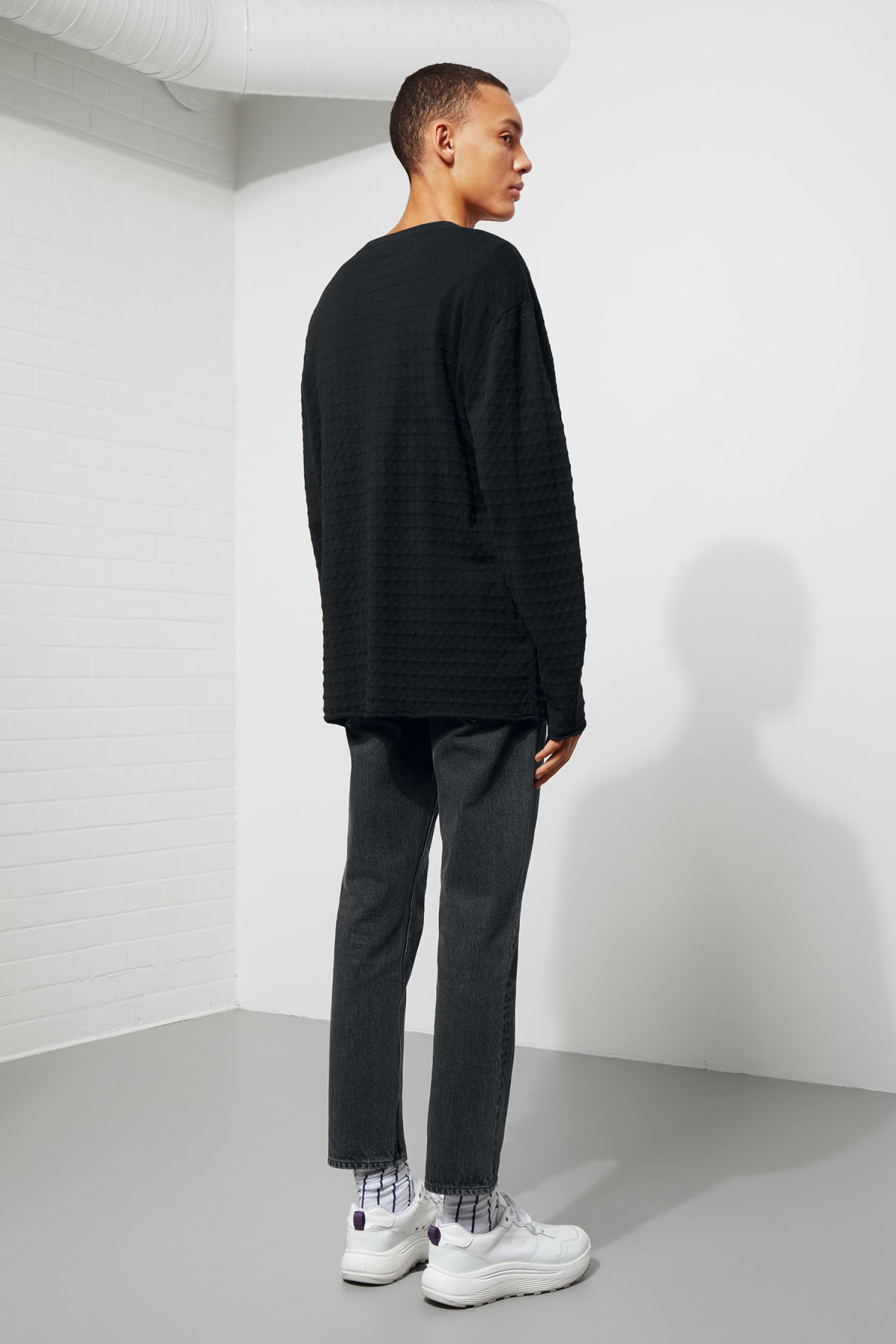 Model back image of Weekday prism sweater  in black