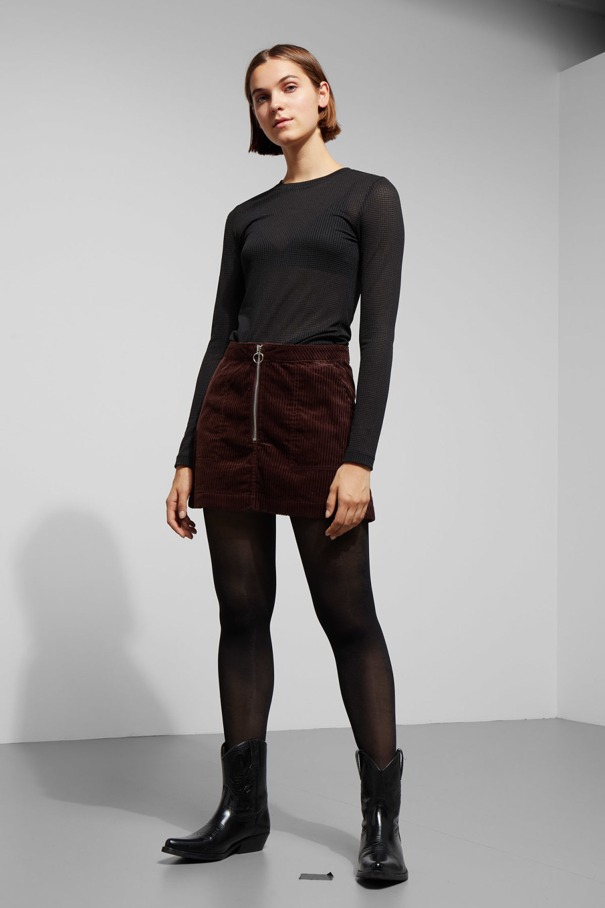 Model front image of Weekday piet mini skirt in brown