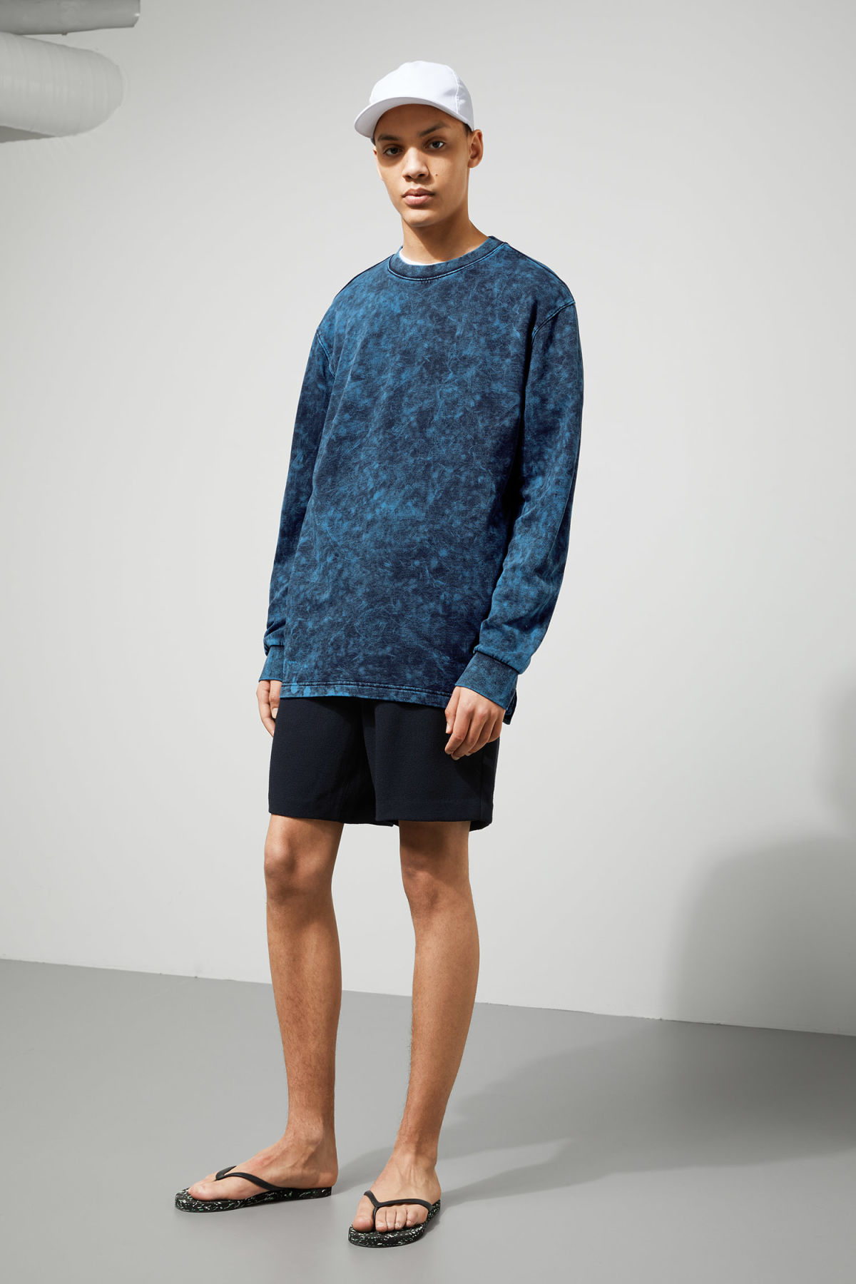 Model side image of Weekday radical washed sweatshirt in black