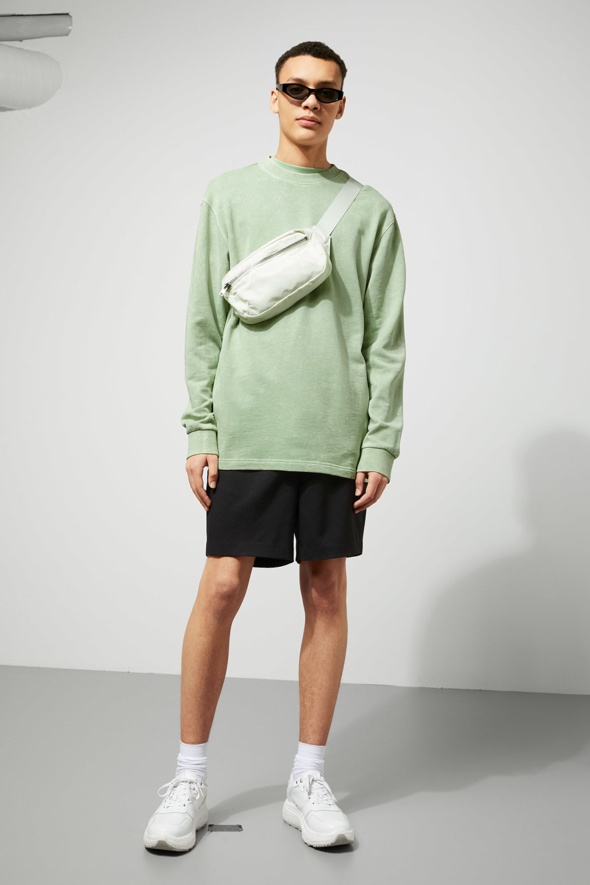 Model side image of Weekday radical washed sweatshirt in green
