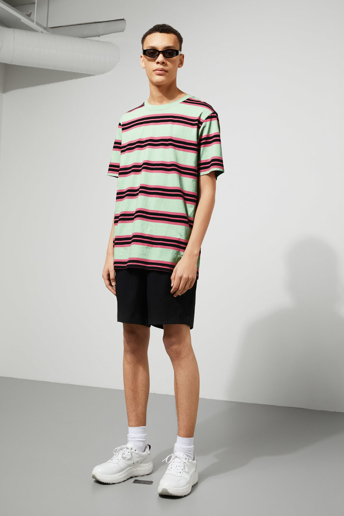 Model side image of Weekday frank striped t-shirt  in green