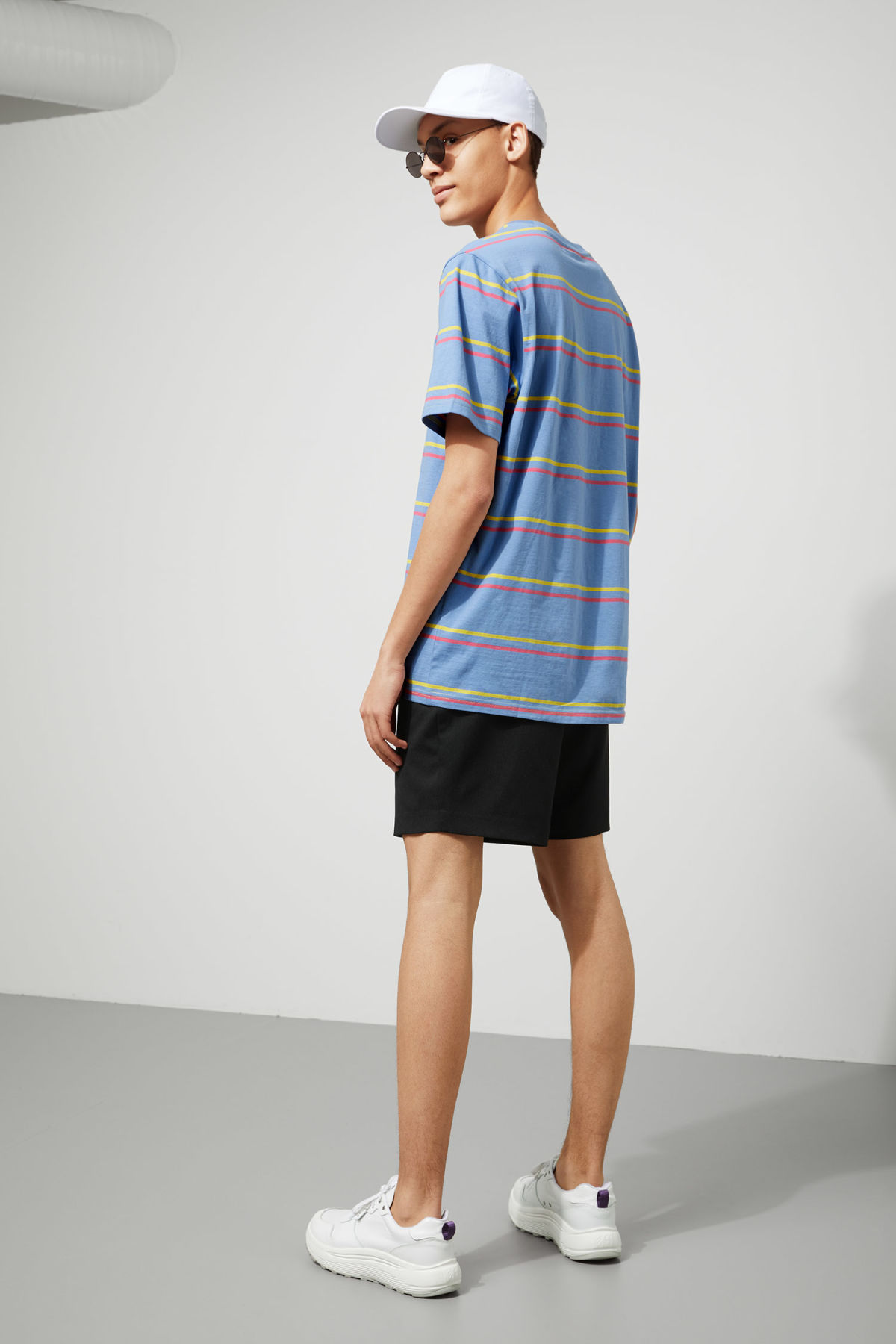 Model back image of Weekday frank striped t-shirt  in blue