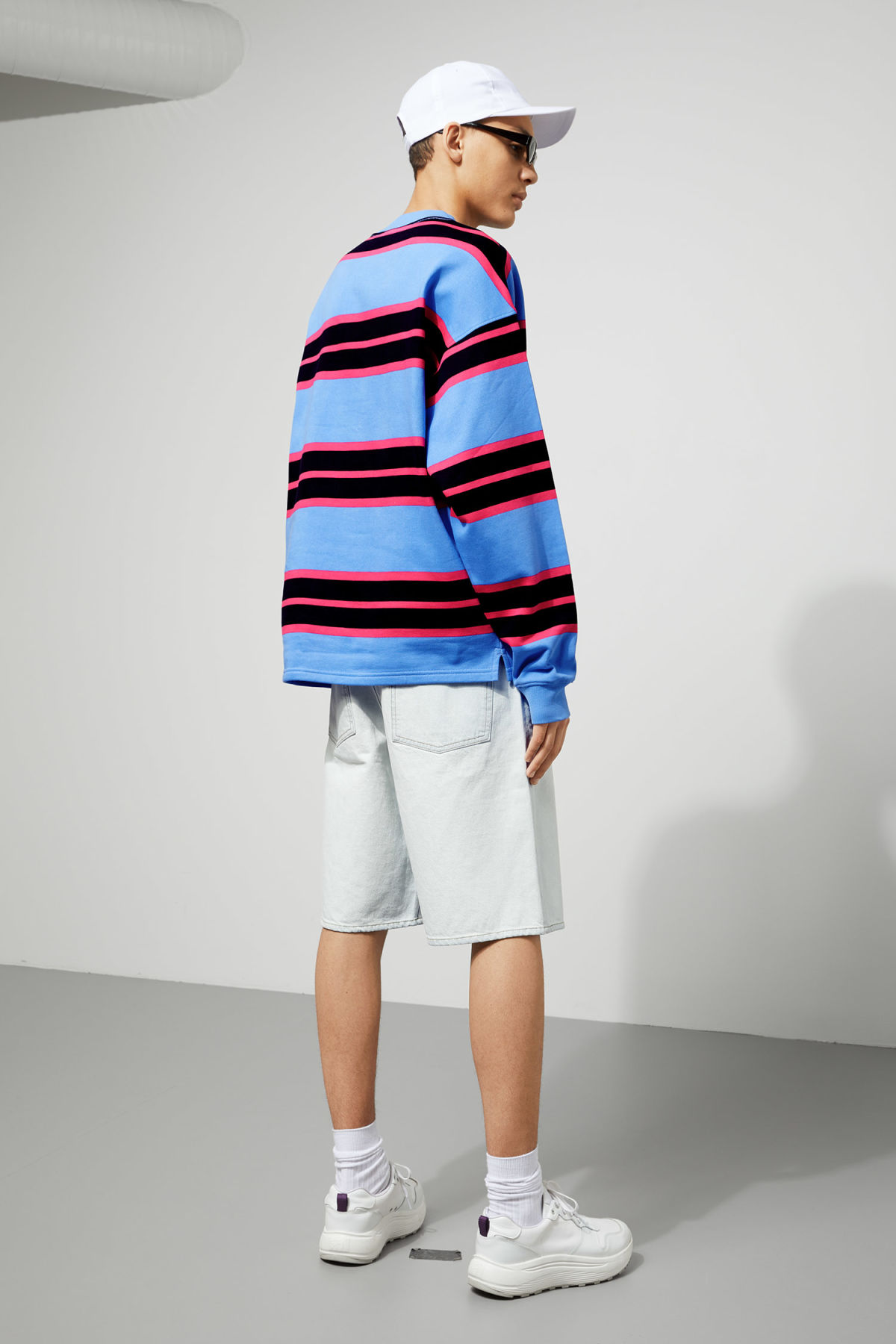Model back image of Weekday sid striped sweatshirt in blue