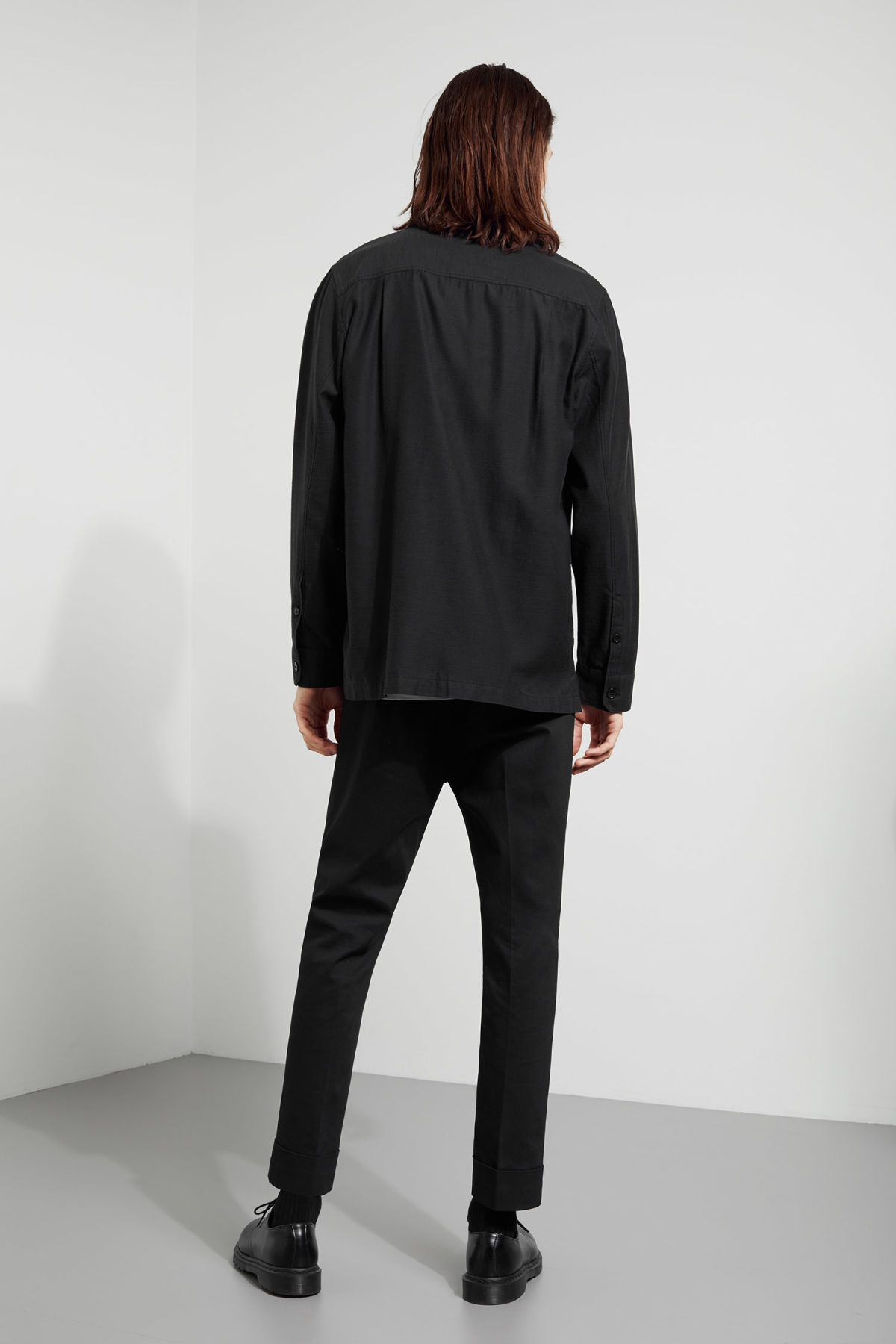 Model side image of Weekday bean shirt in black