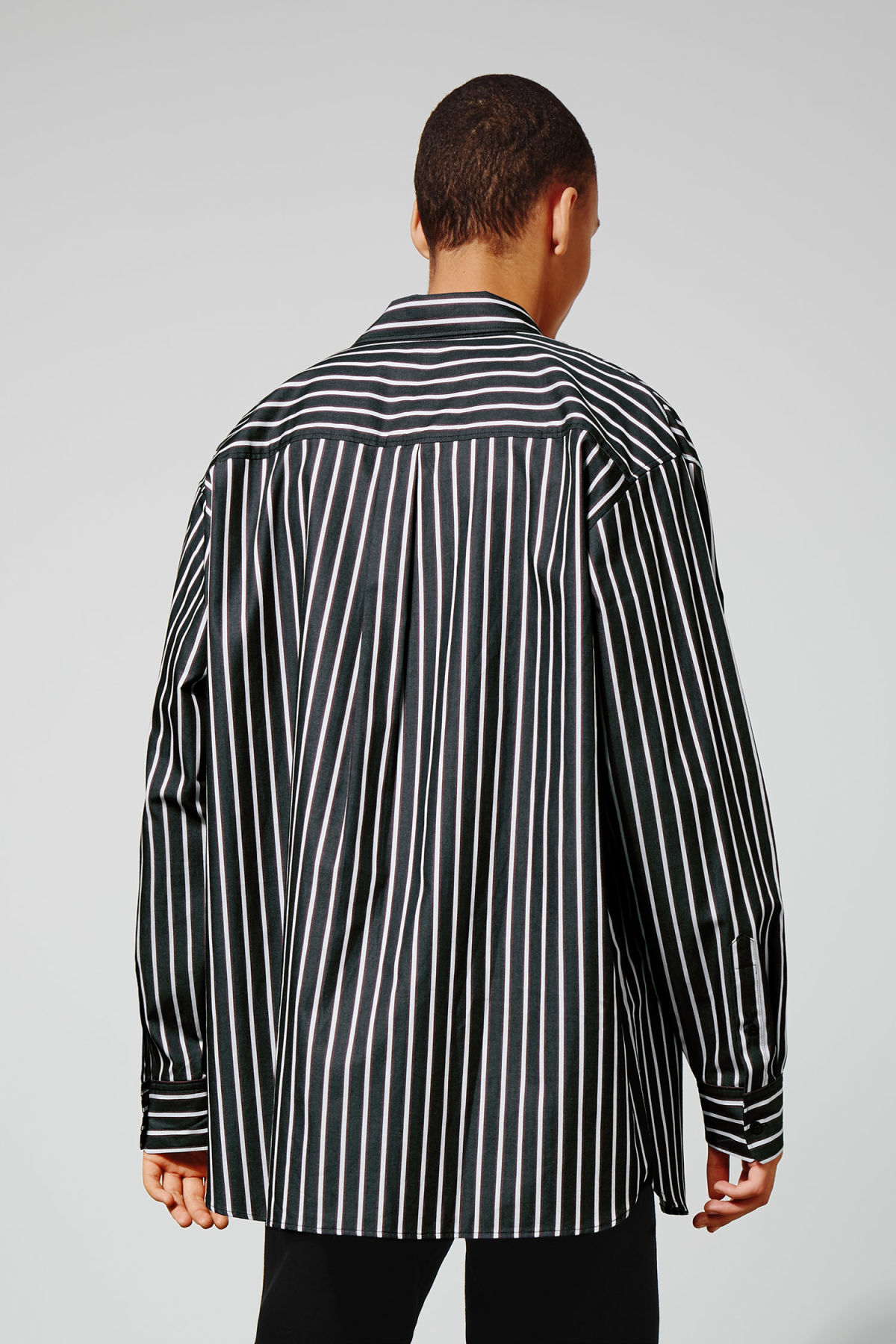 Model side image of Weekday burg stripe shirt  in blue