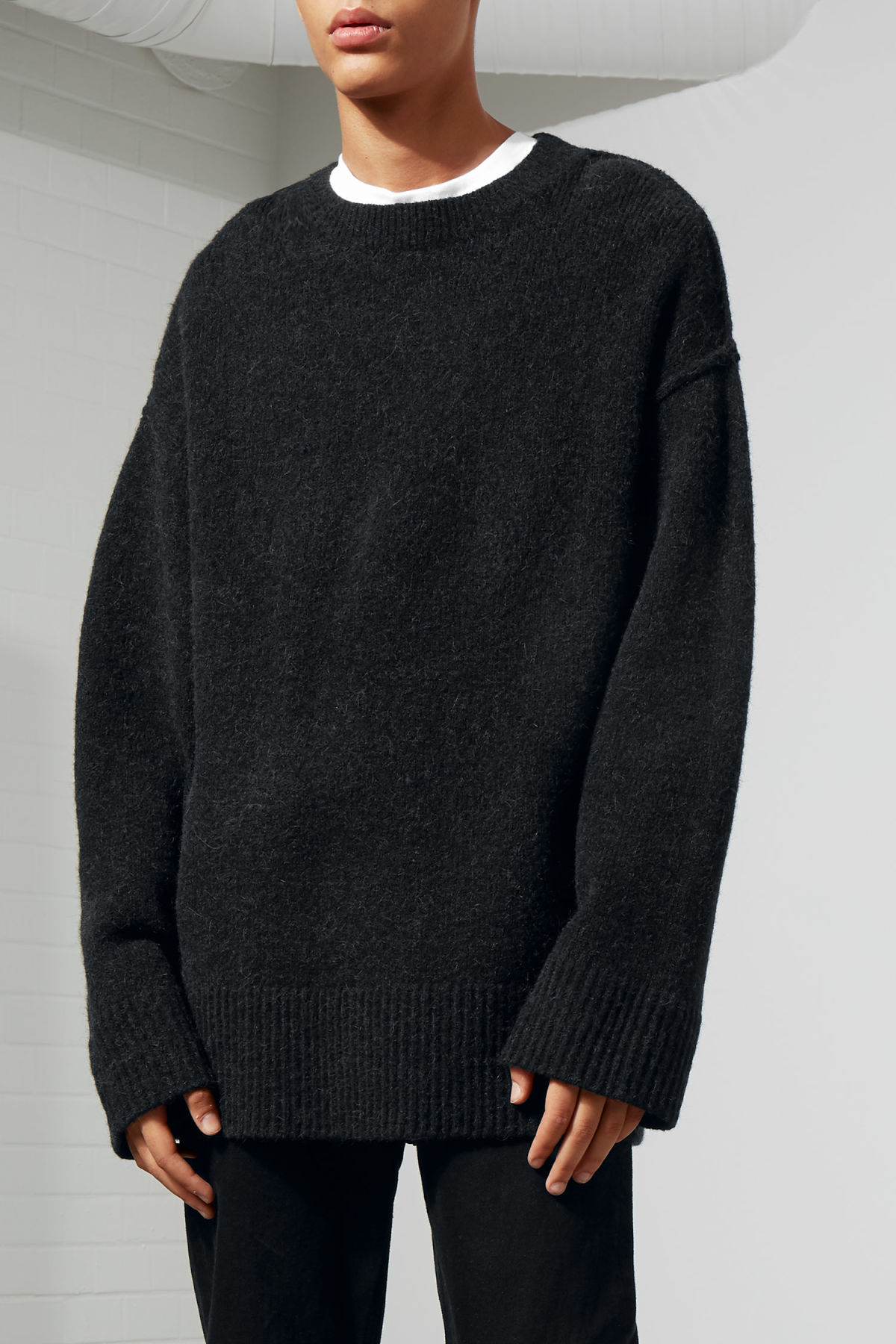 Model front image of Weekday cutter sweater in black